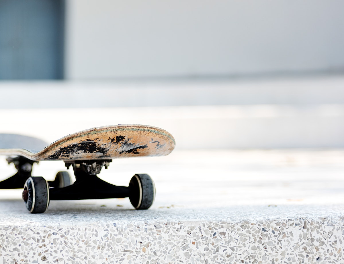 Closeup of skateboard on white floor