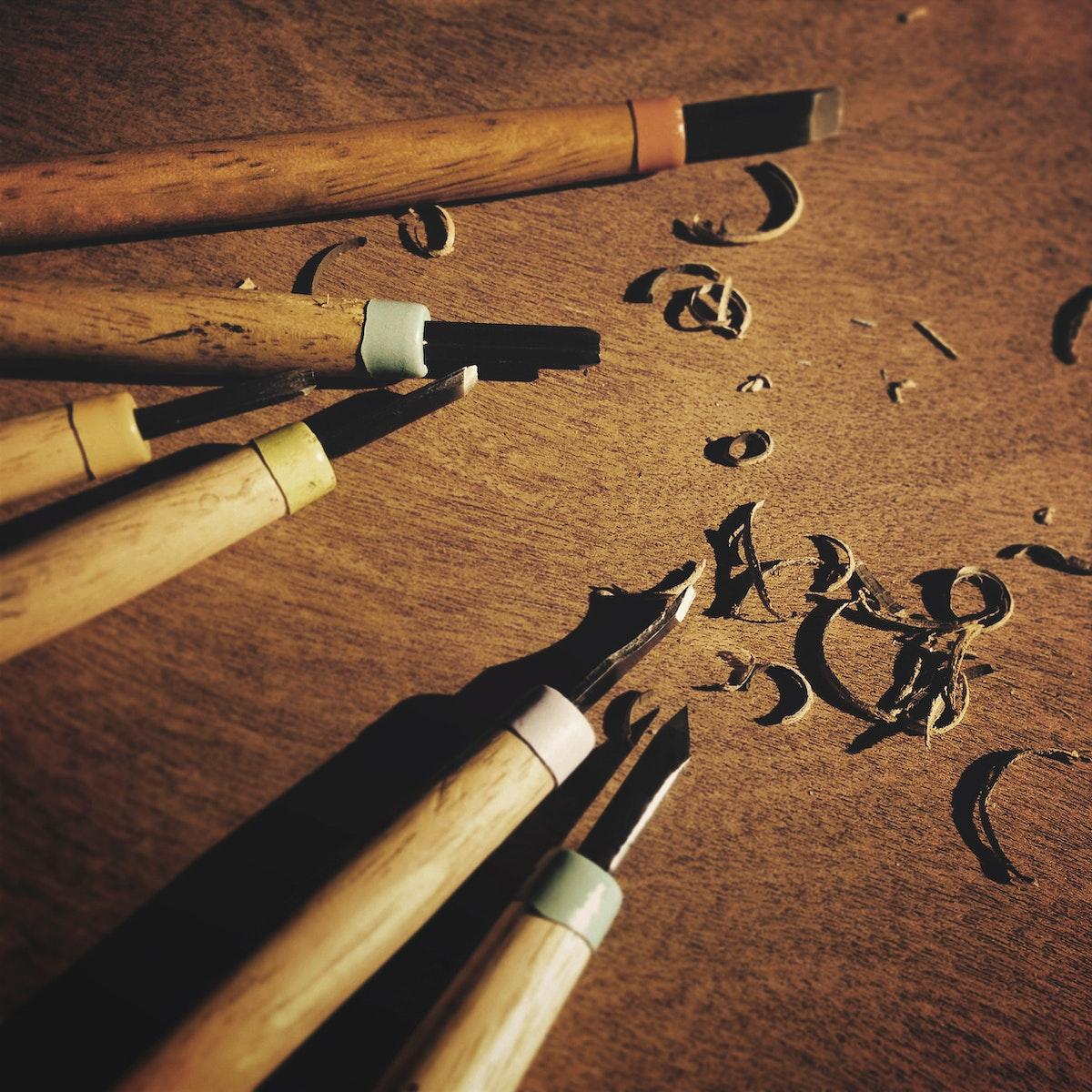 Closeup aerial view of wood sculpter carpenter chisel tools