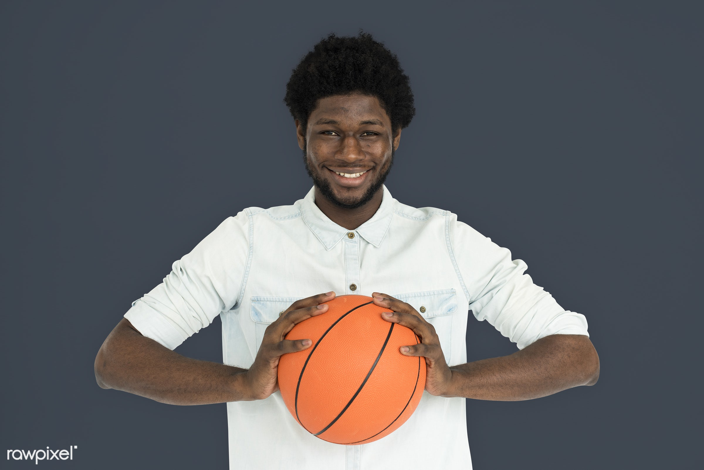 studio, basketball, expression, earth tone, person, holding, people, lifestyle, cheerful, smiling, isolated, laugh, hobby,...