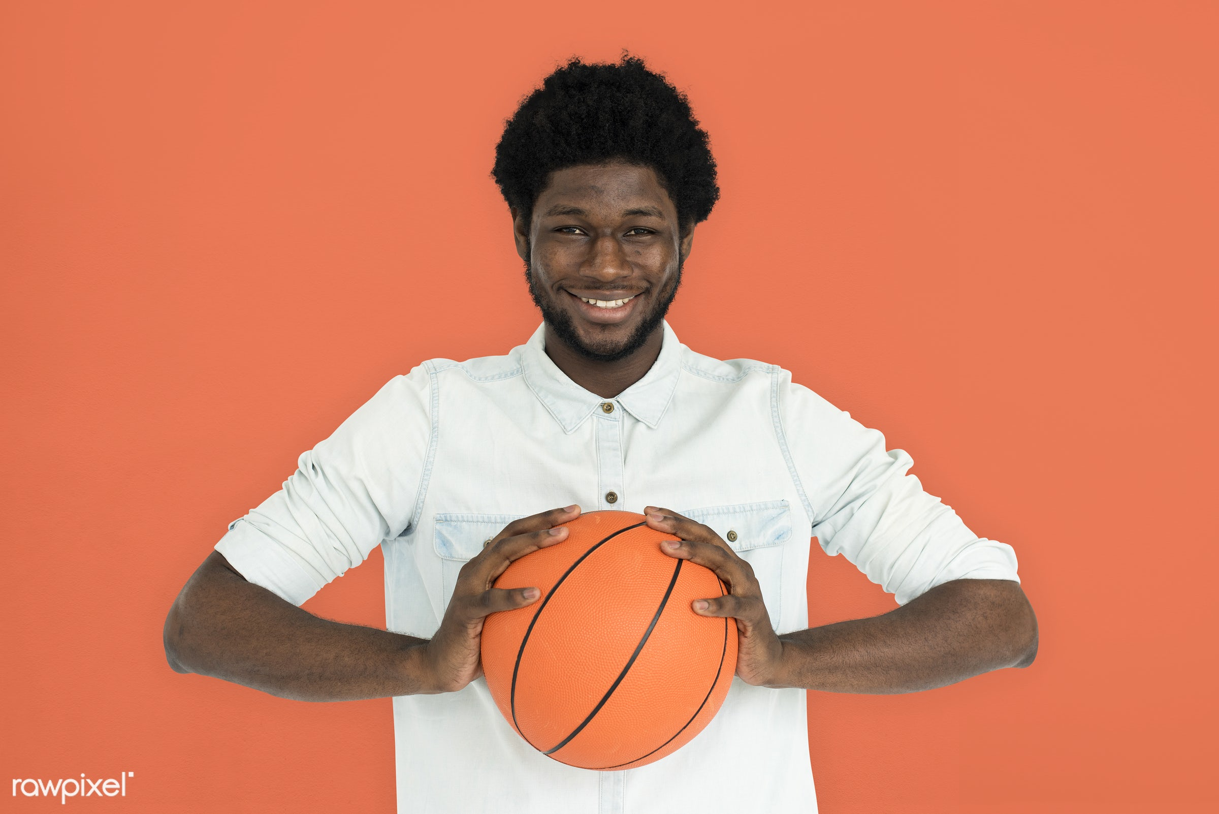 studio, basketball, expression, person, holding, people, lifestyle, cheerful, smiling, orange, isolated, laugh, hobby,...
