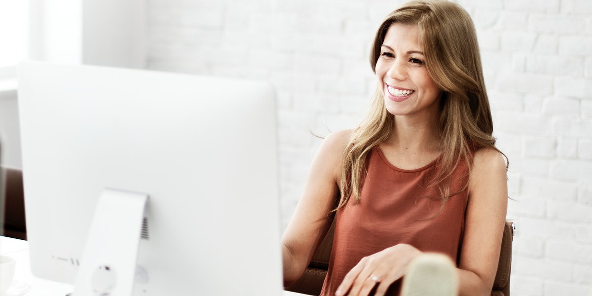 Cheerful woman at her computer