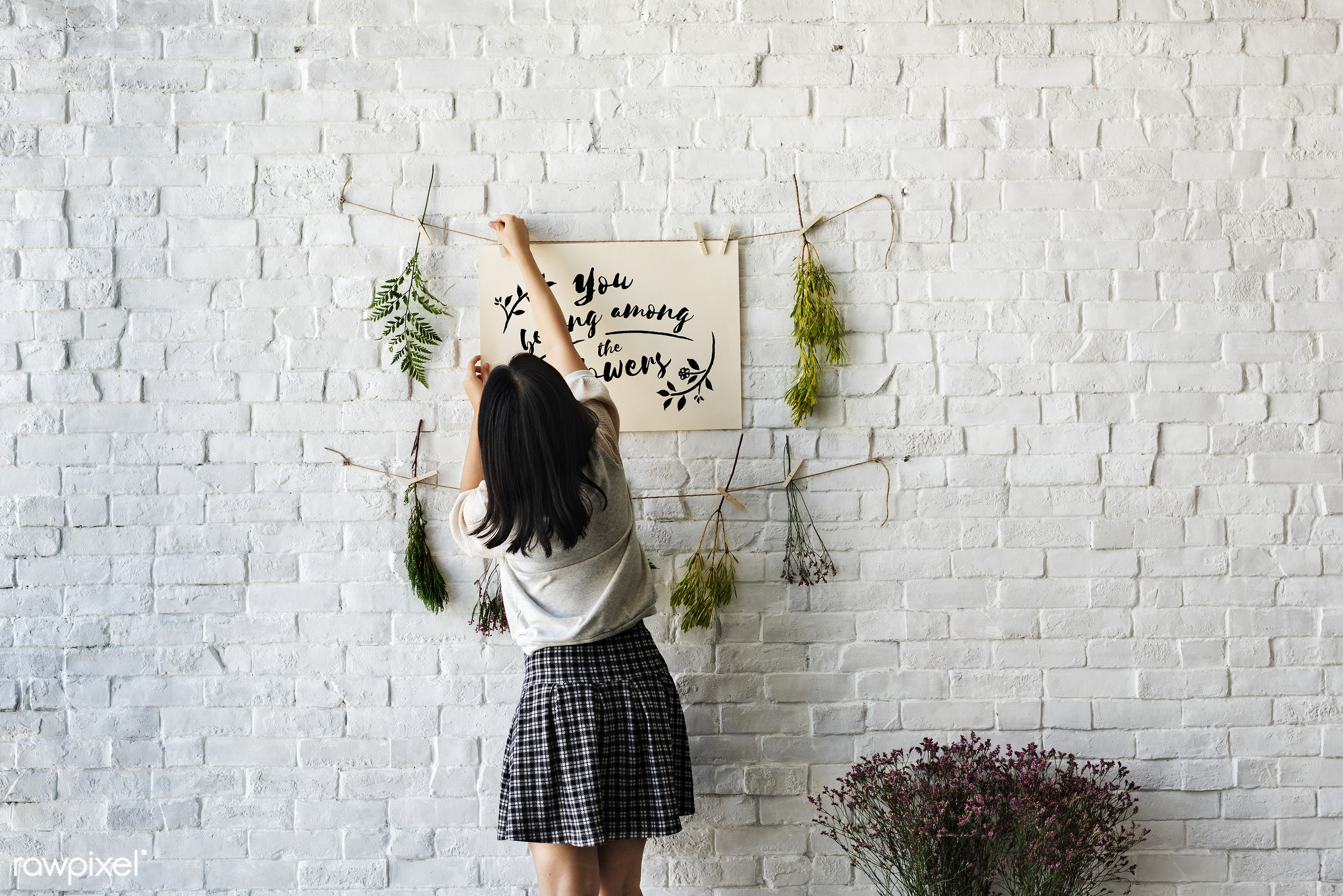 A woman decorating the wall with flowers - lifestyle, florist, girl, decorating, floral, woman, relax, smell, present, rear...