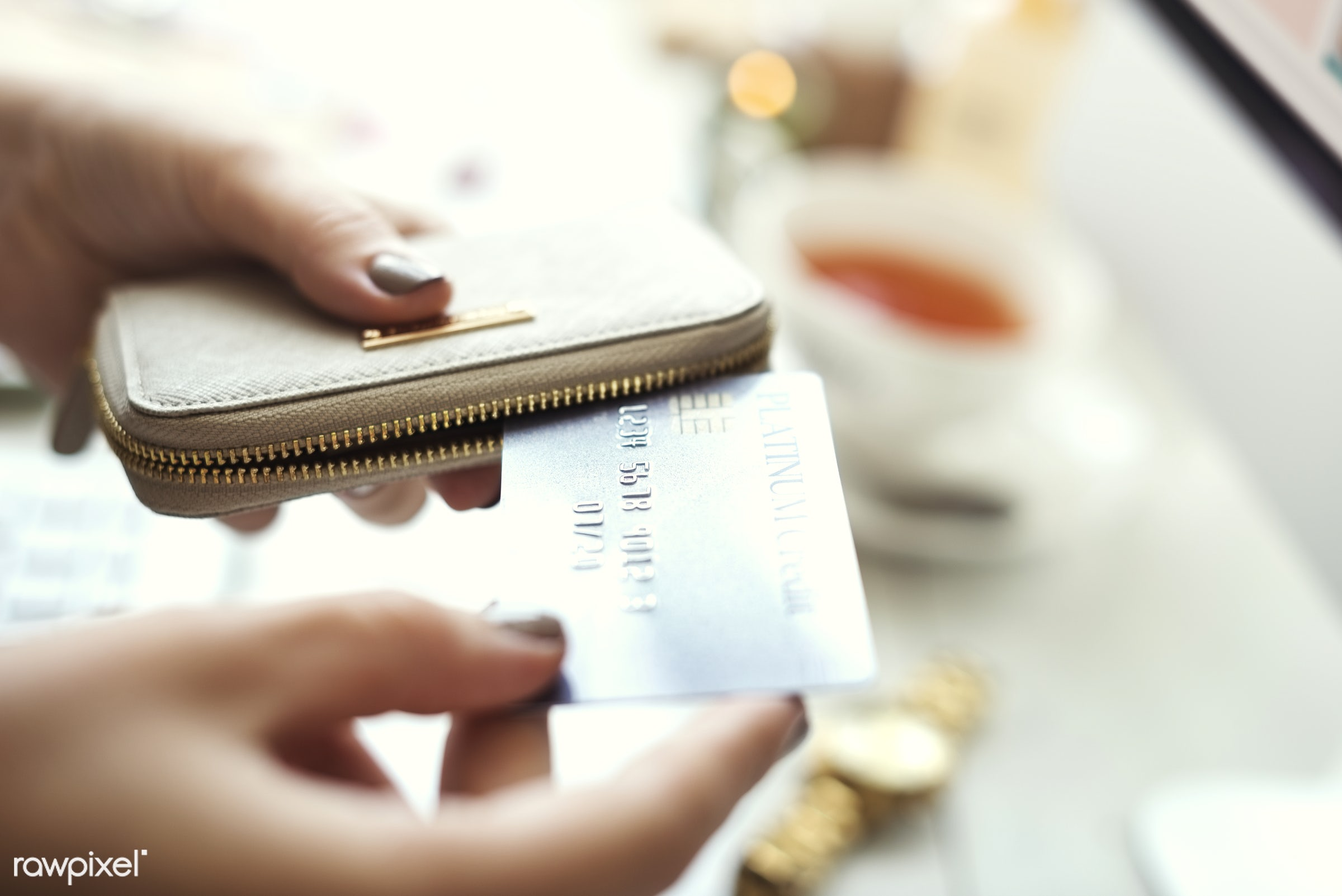 Closeup of hands holding credit card - payment, credit, online shopping, card, accounting, banking, commerce, convenience,...