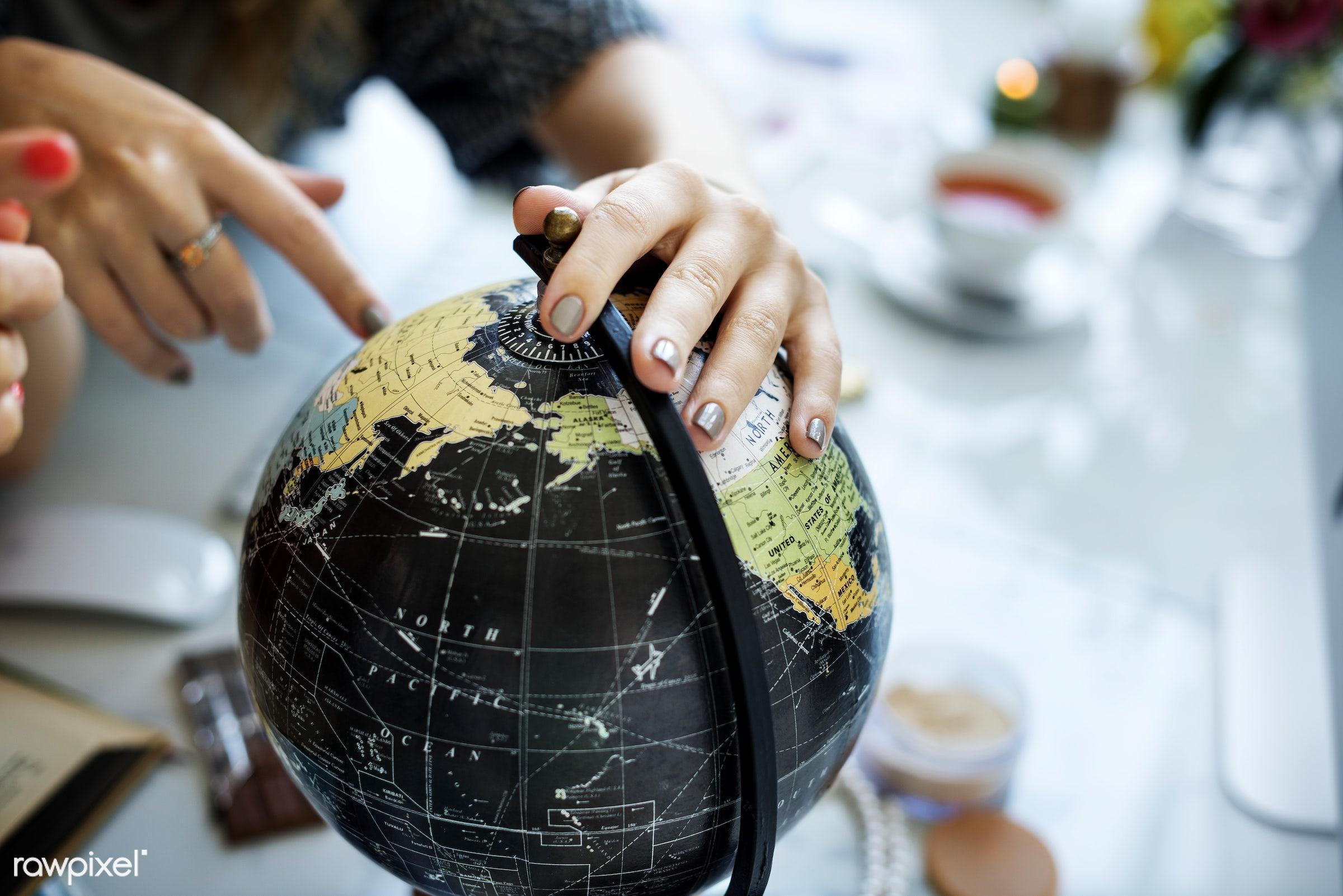 World globe traveler - adventure, destination, expedition, explore, geography, global, globe, hand, journey, lifestyle,...