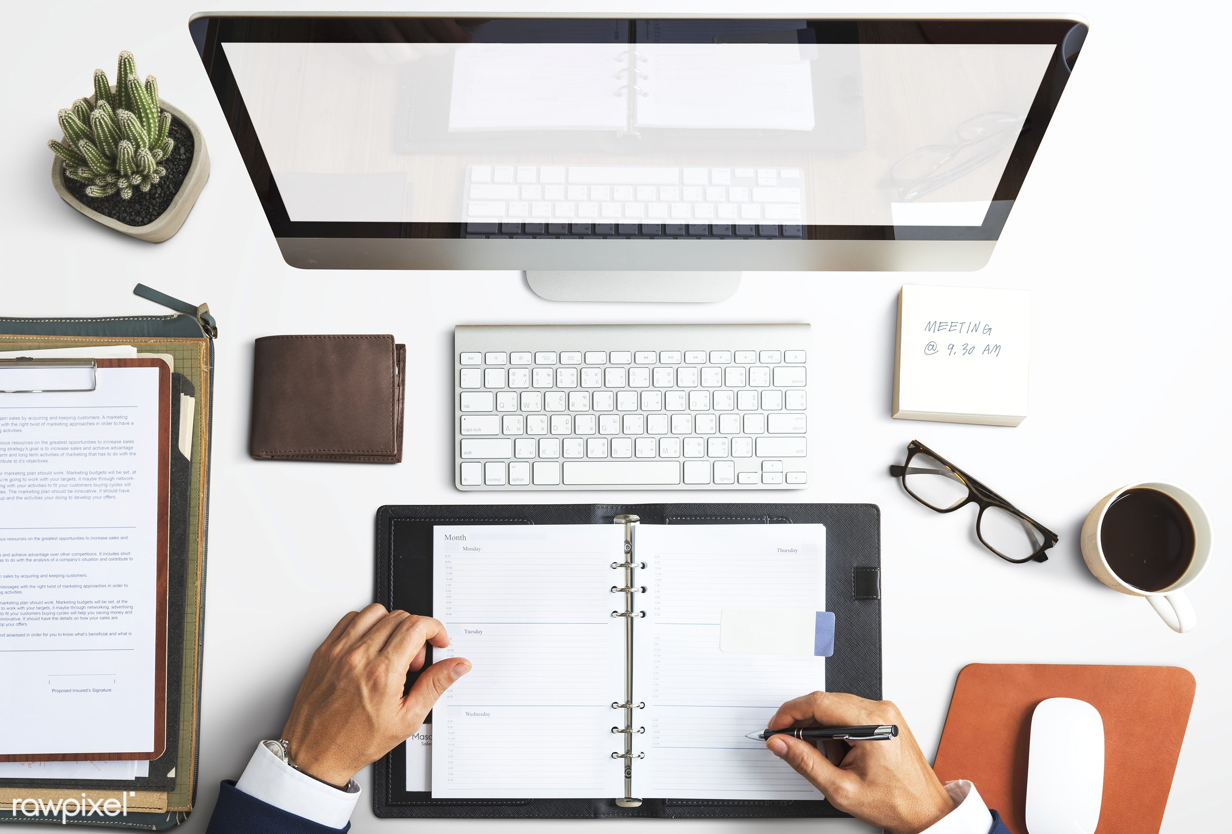 Caucasian businessman in the office shoot - desk, business, businessman, writing, aerial view, blank, book, business plan,...