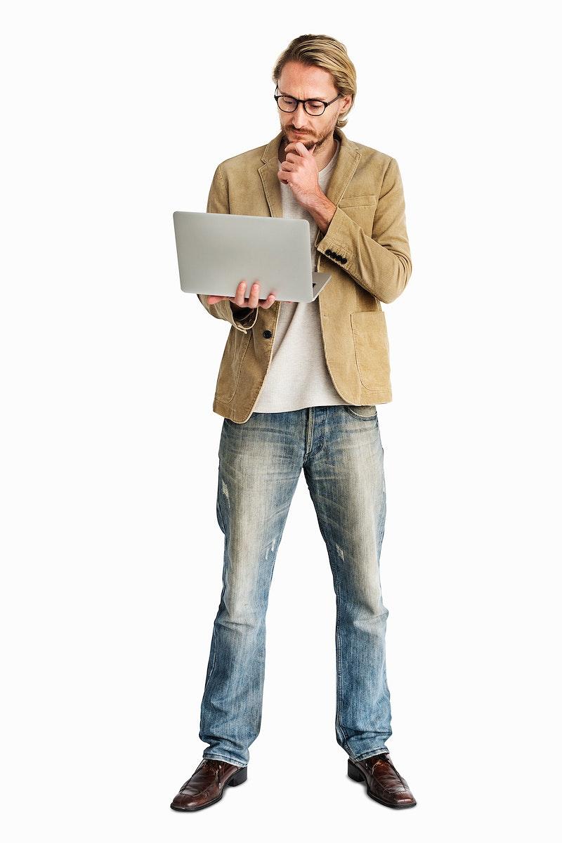 Casual man using his laptop