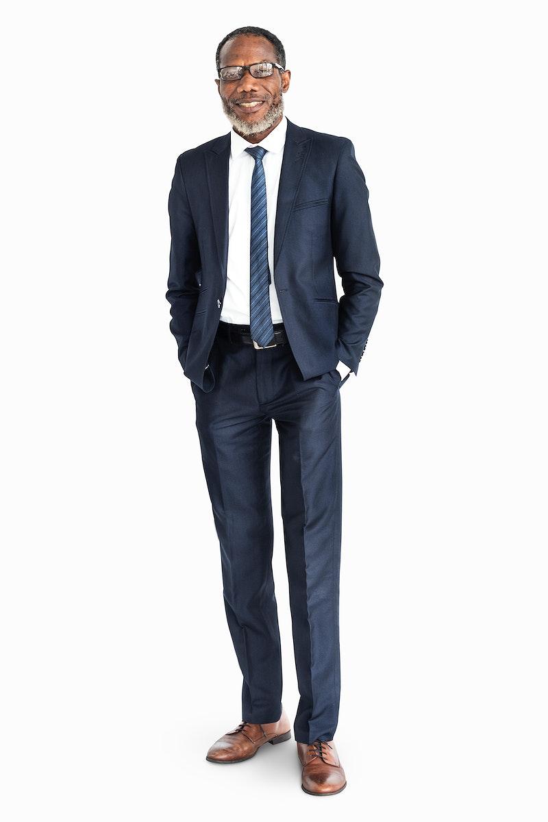 Businessman standing smiling