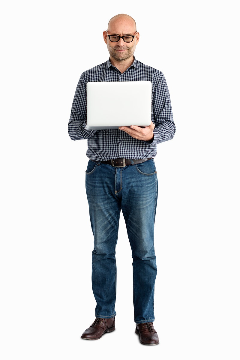 Casual man standing using a laptop