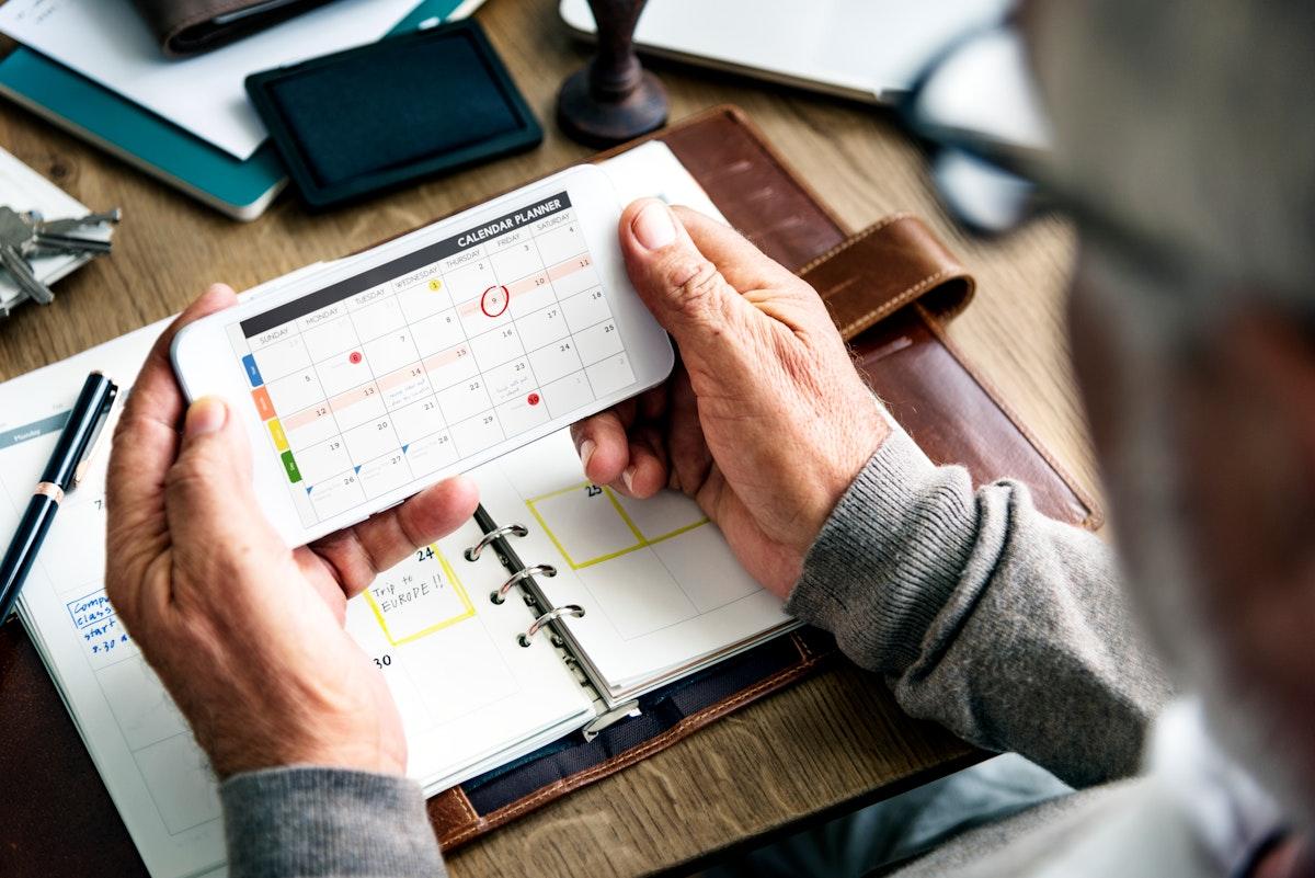 Senior man checking his calendar
