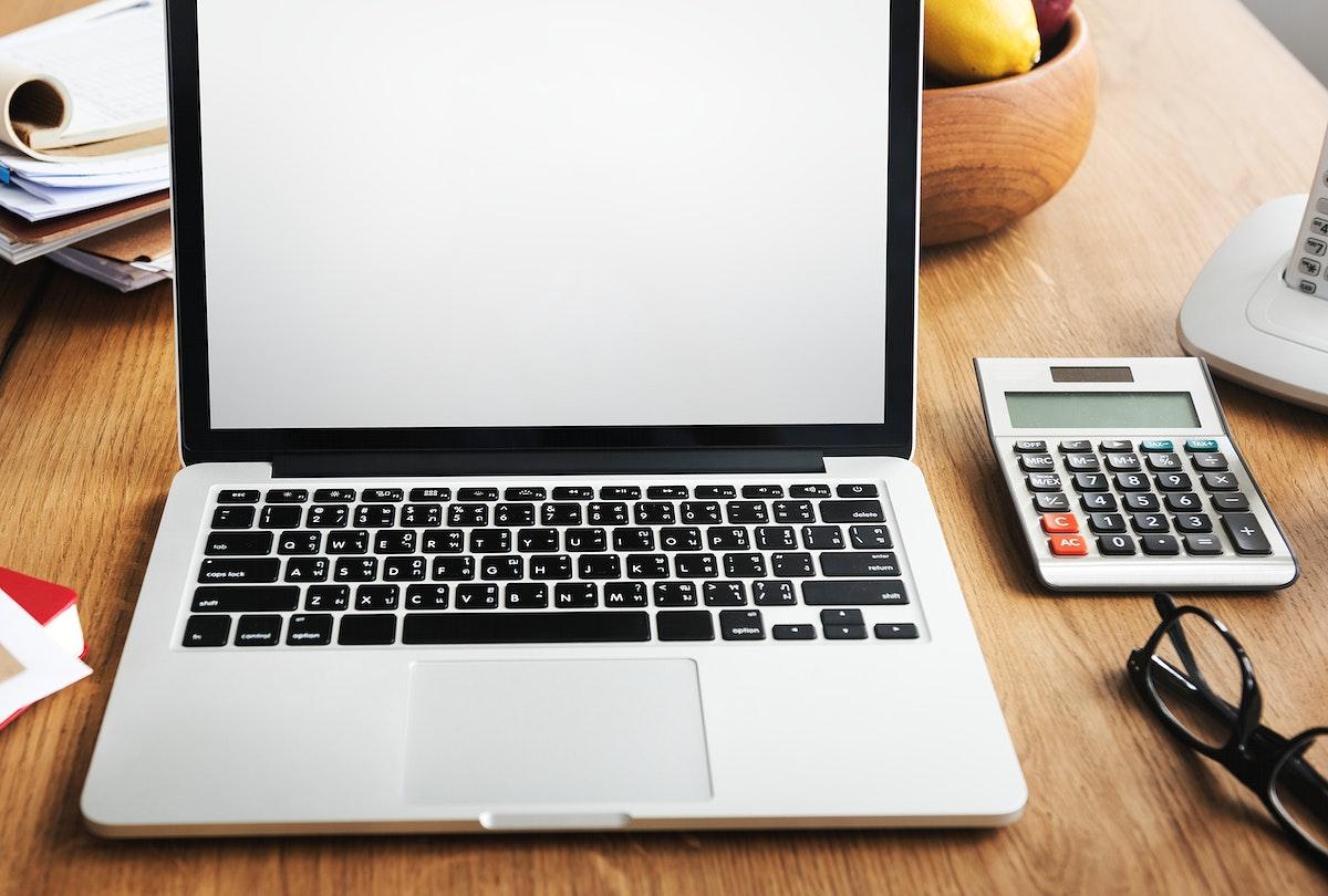 Laptop on a breakfast table