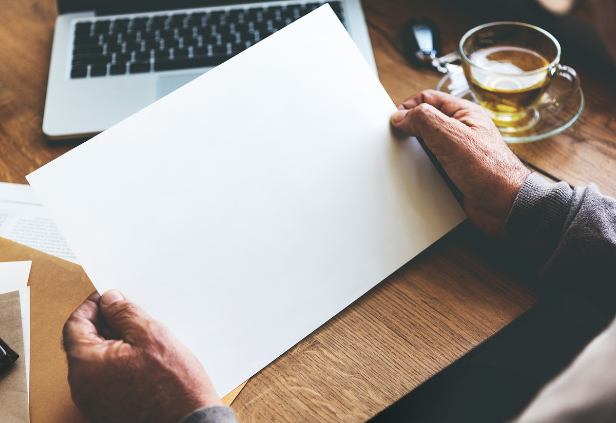 Senior man holding a blank paper