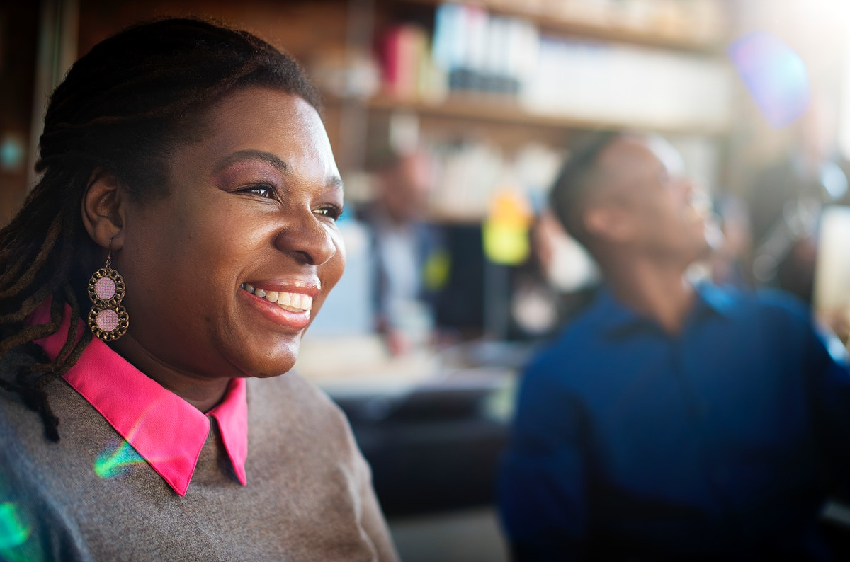 Closeup of black woman smiling cheerful at workplace