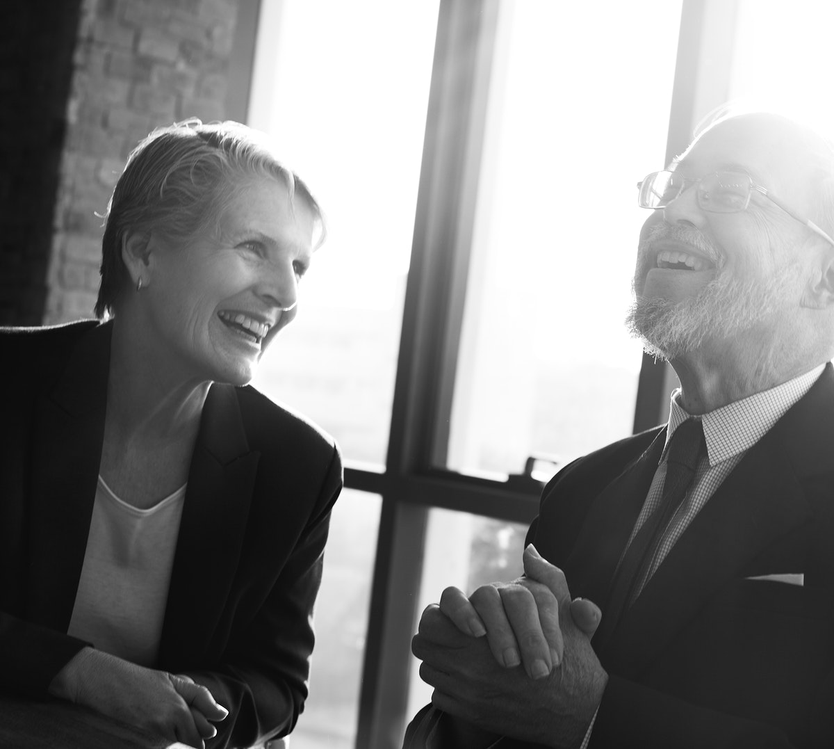 Closeup of caucasian business people smiling at meeting