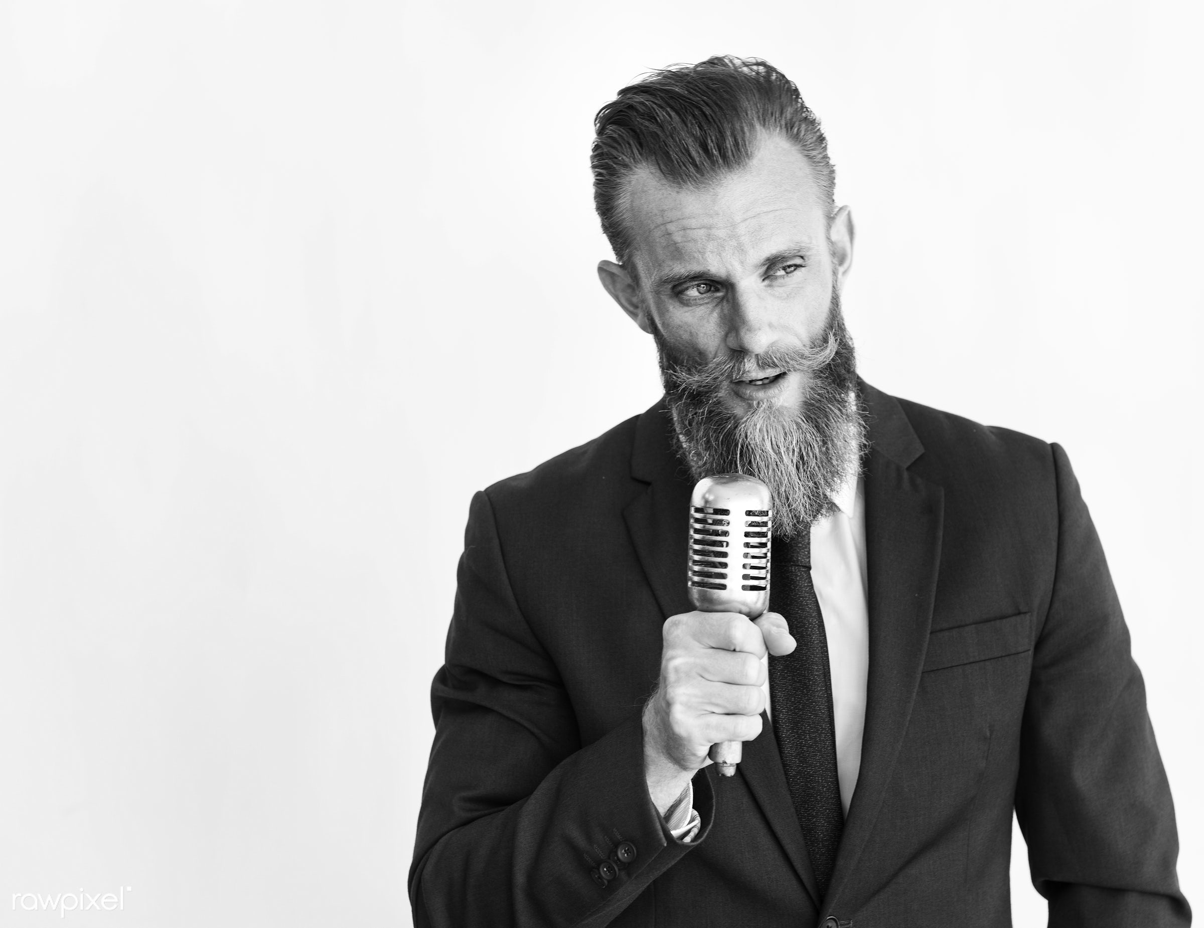 Business man talking on microphone grayscale - beard, speaking, mustache, alone, black and white, business, closeup, formal...