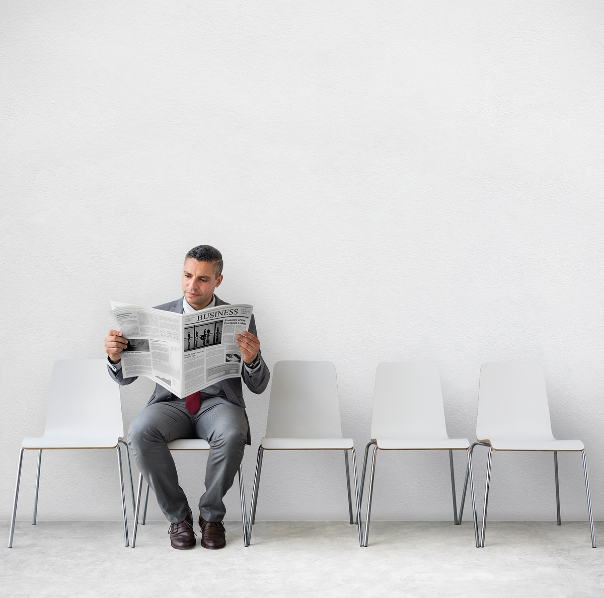 Businessman Reading Newspaper Workplace Concept