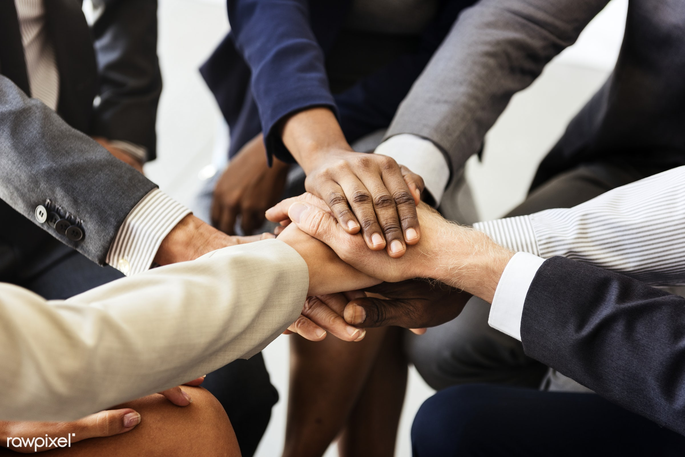 Business people joined hands together as teamwork - business, deal, power, friendship, cooperation, support, team, agreement...