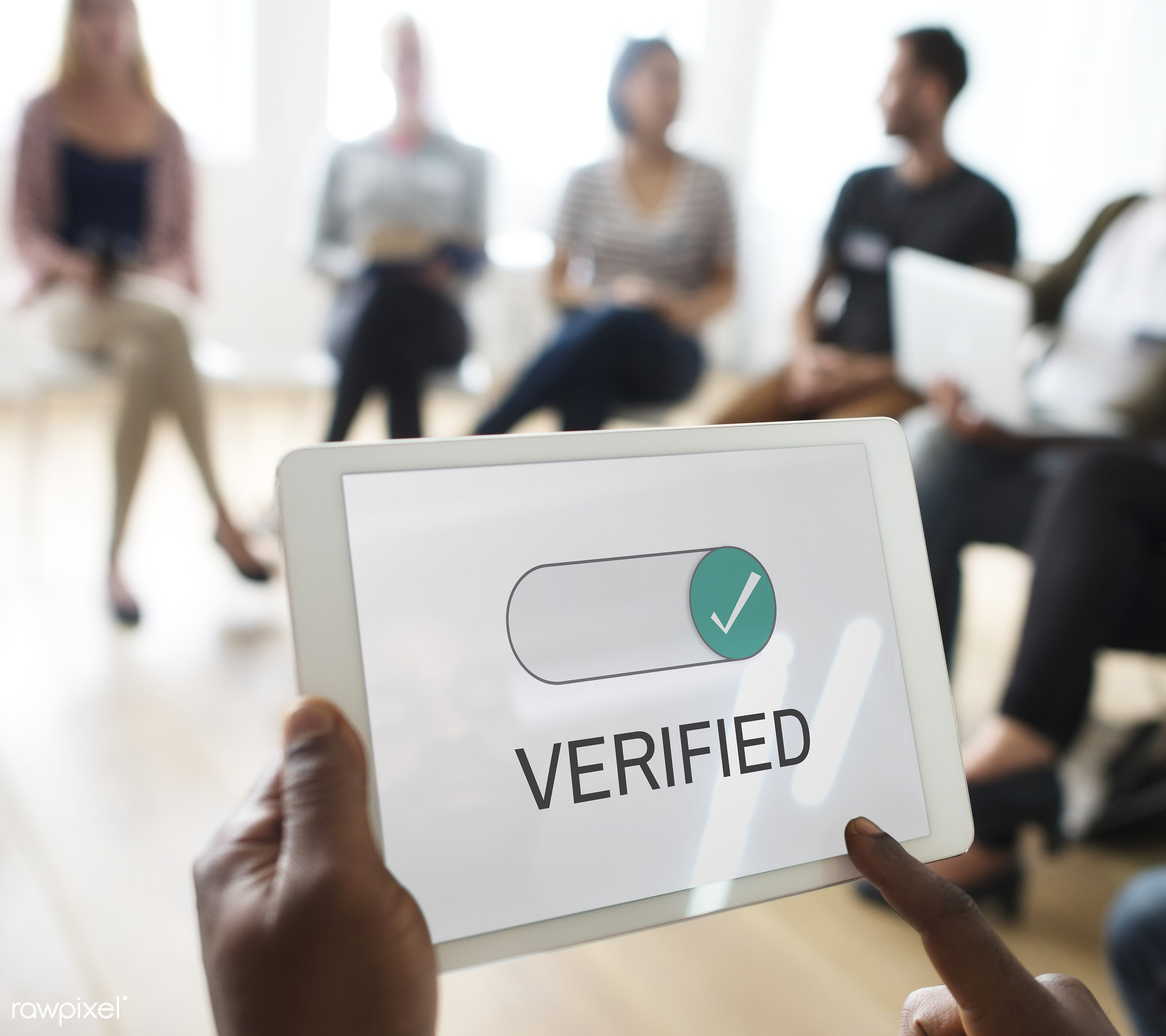 Man holding tablet with verified in seminar - allow, allowance, approval, approve, authority, authorization, authorize,...
