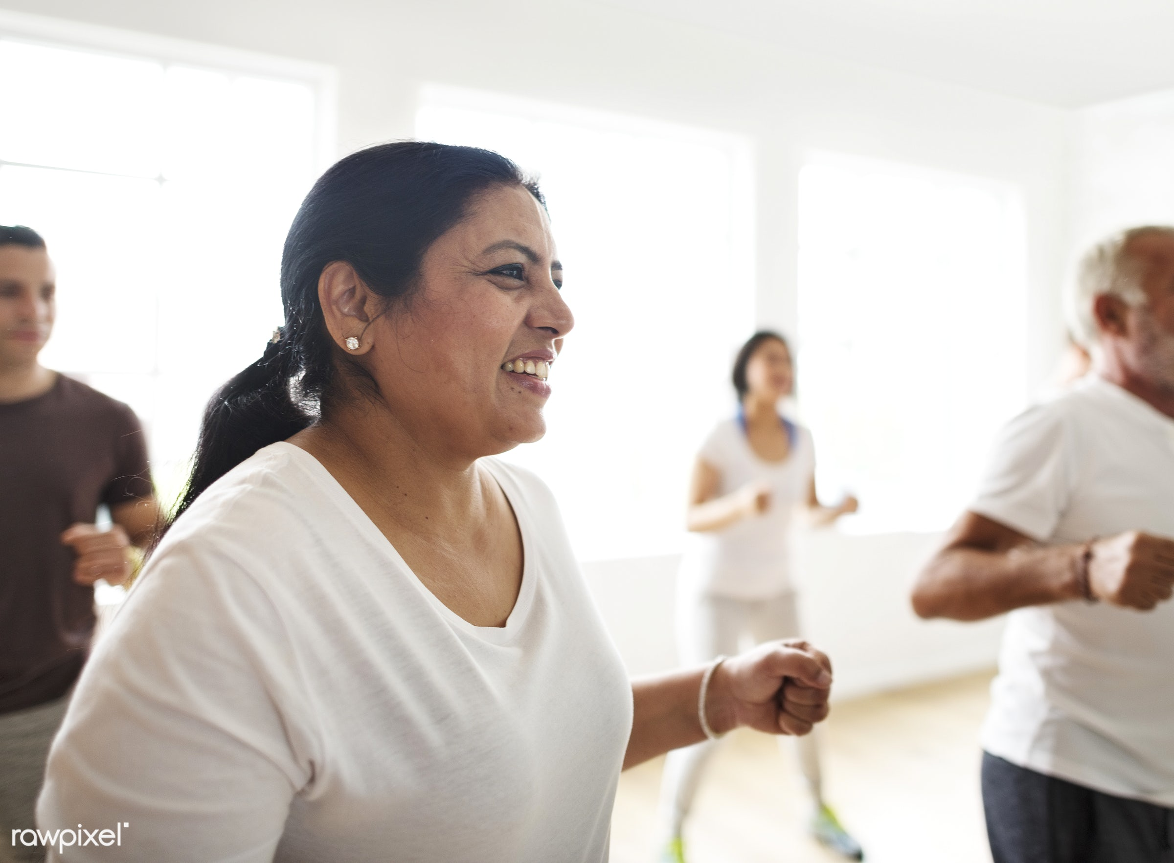 Closeup of an happy Indian woman in an excercise class - respiration, physical, diverse, relax, variation, recreation,...