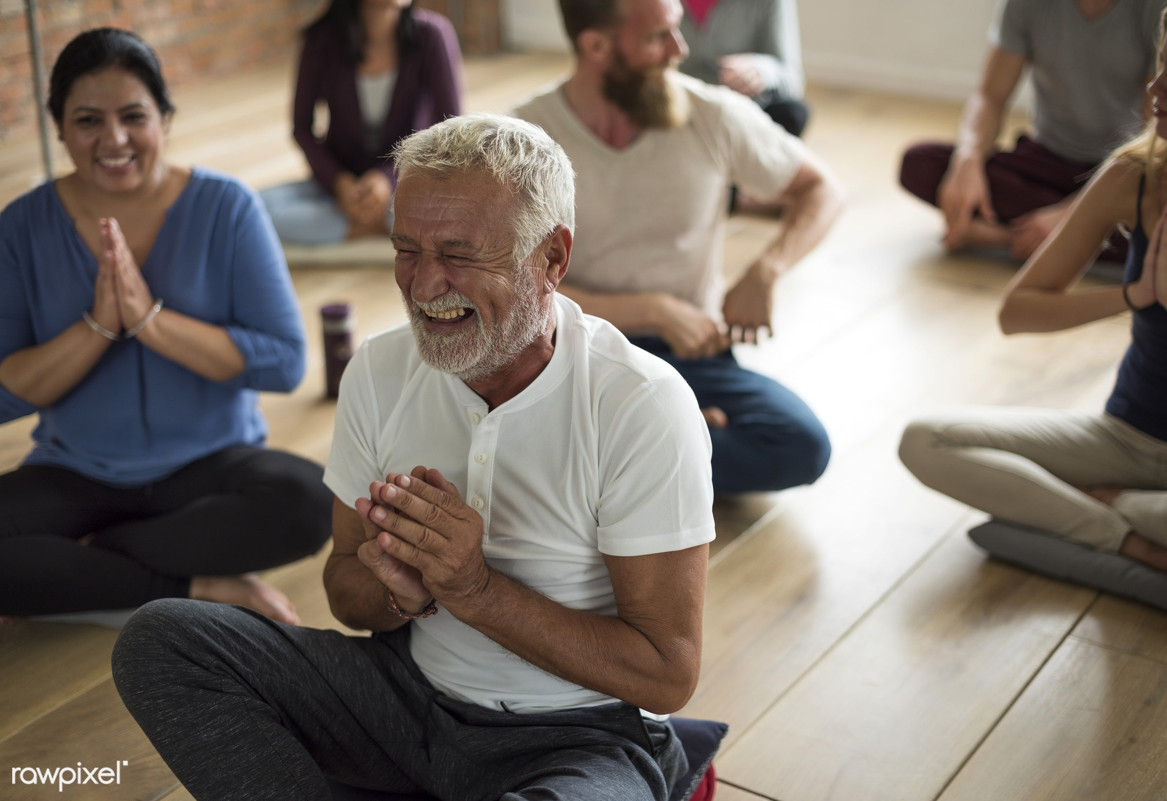 Happy senior man in a yoga class - respiration, physical, diverse, recreation, people, stretching, together, balance,...