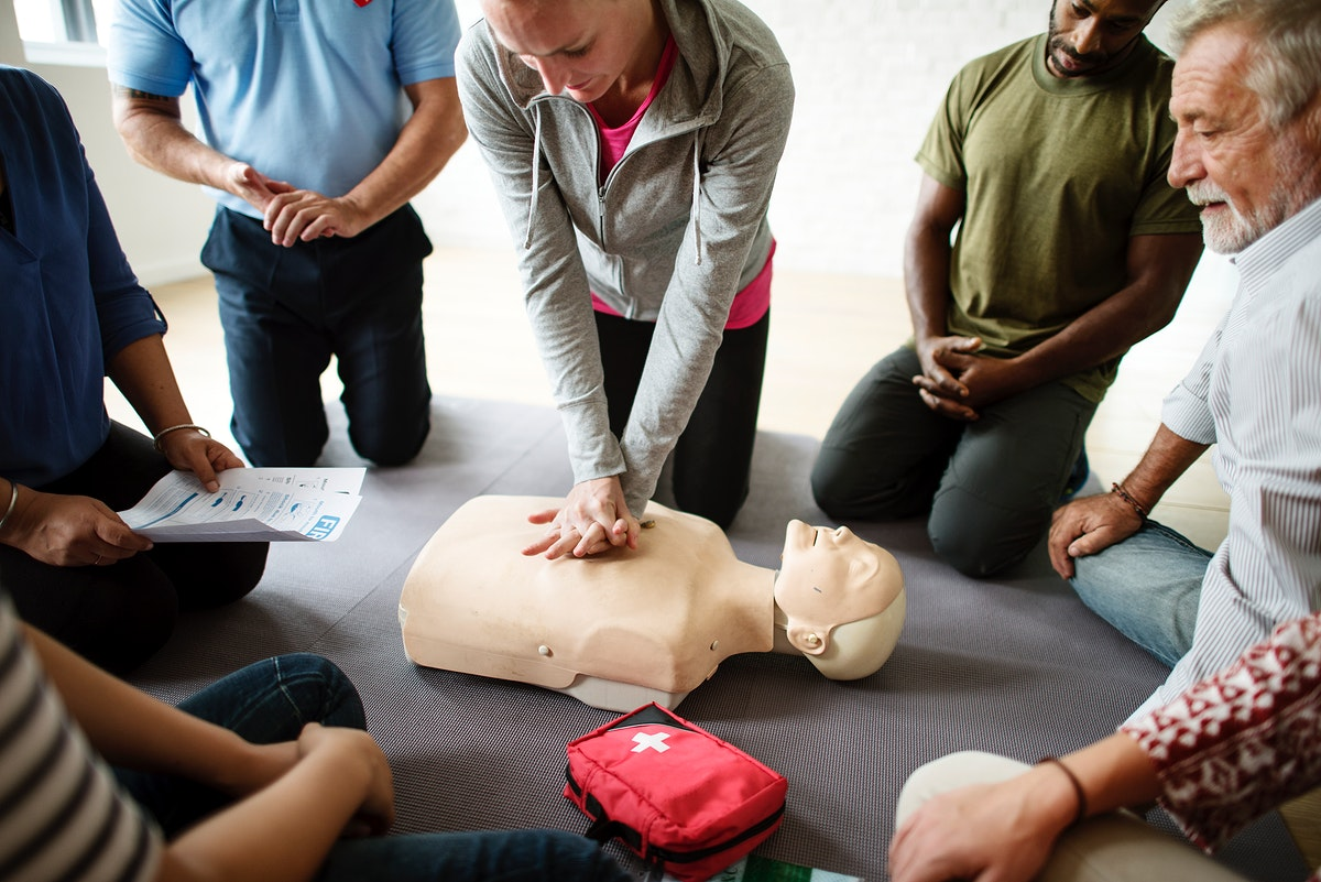 Group of diverse people in cpr training class