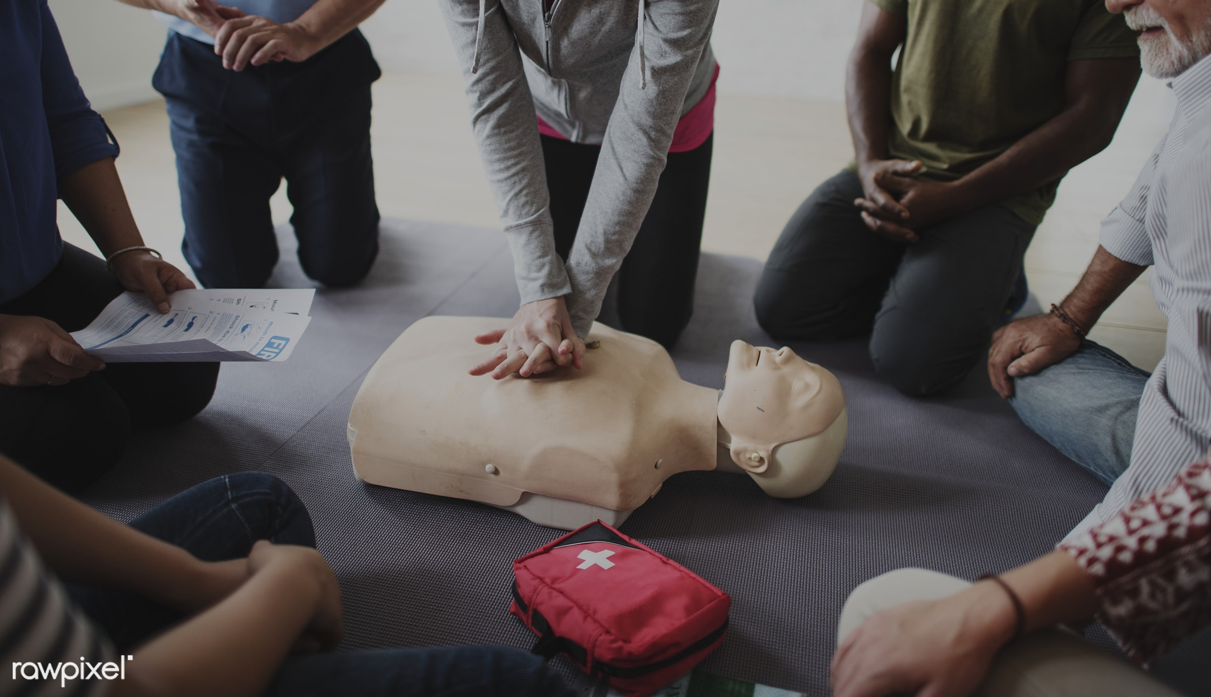 Diverse people taking a CPR first aid training class - cpr training, person, knowledge, save, first aid, resuscitation,...