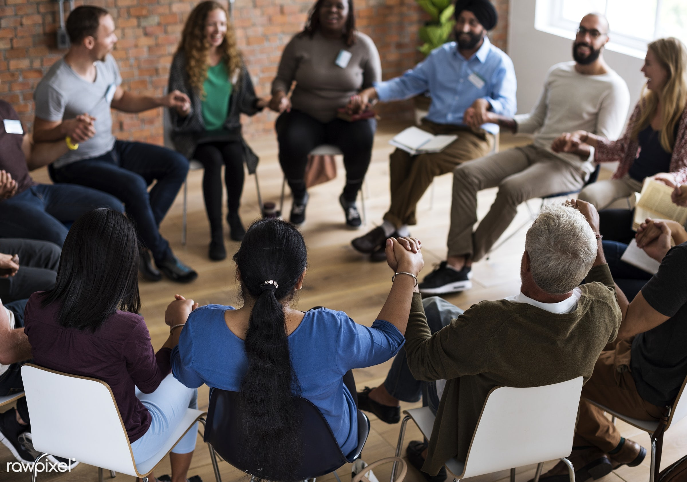 Diverse group of people in a seminar - collaboration, african ethnicity, chairs, holding, indian ethnicity, circle, people,...
