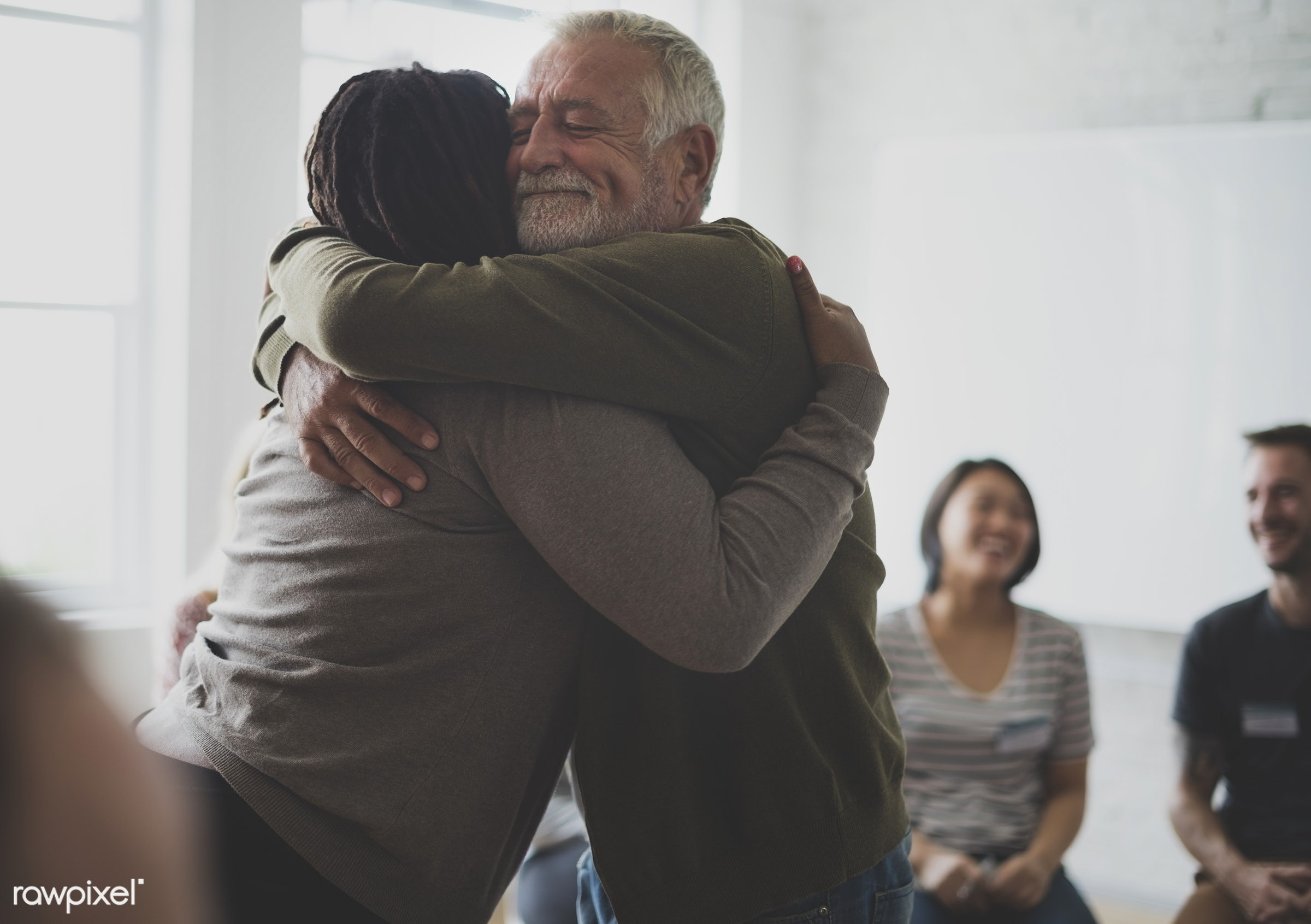 Old guy consoling a woman with a hug - discussion, hug, diverse, bonding, people, caucasian, asian, help, friends, sharing,...