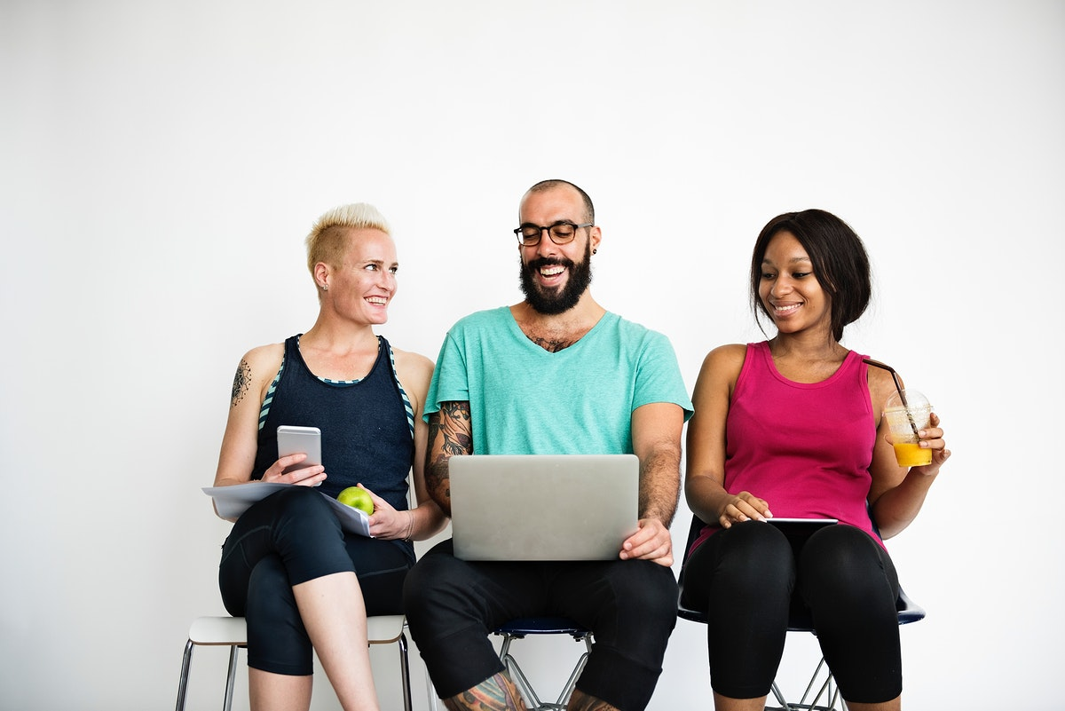 A group of healthy people is using laptop