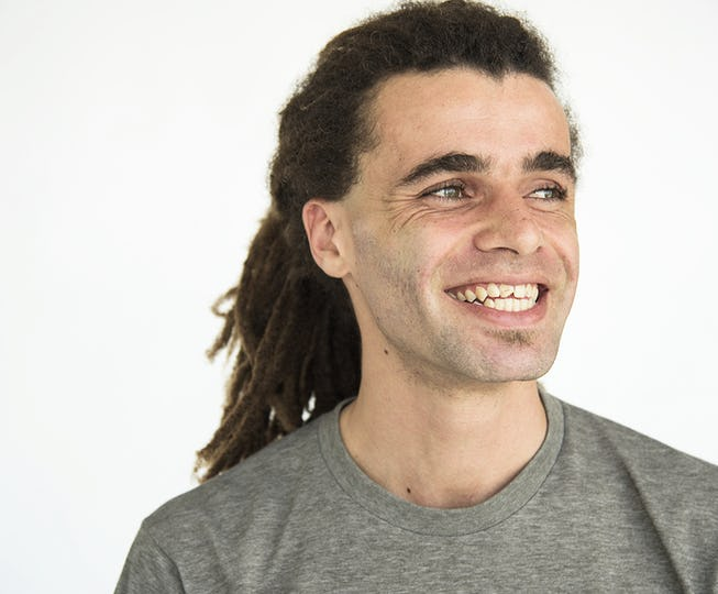 Guy with dreadlocks smiling positive portrait