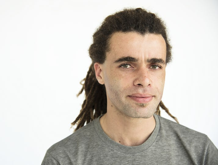 Guy with dreadlocks curious face portrait