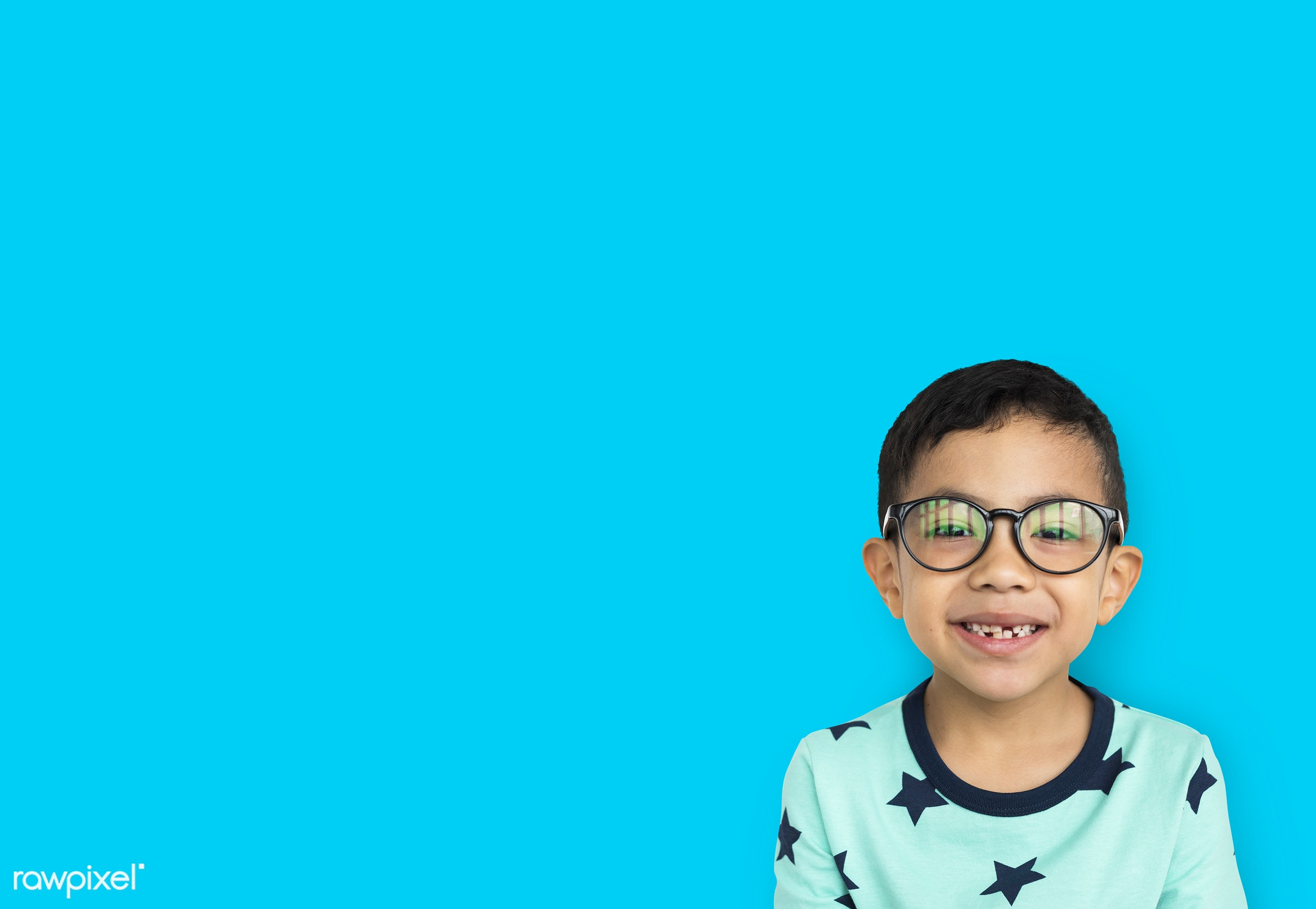 alone, boy, cheerful, child, eyeglasses, isolated, kid, one, playful, smiling, wearing, young, youth