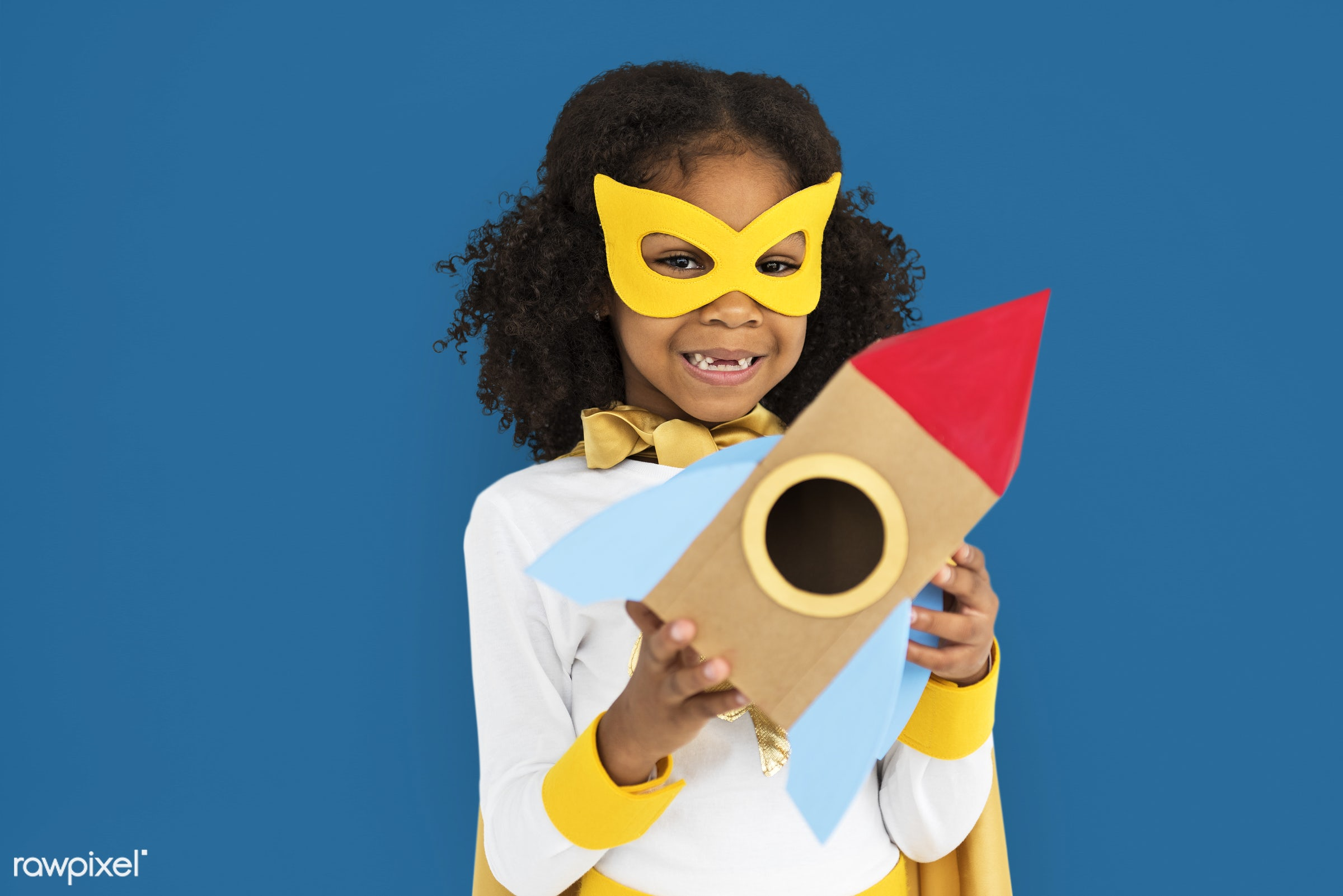african descent, alone, black, cheerful, costume, isolated, kid, one, studio, superhero, telephone, young, youth