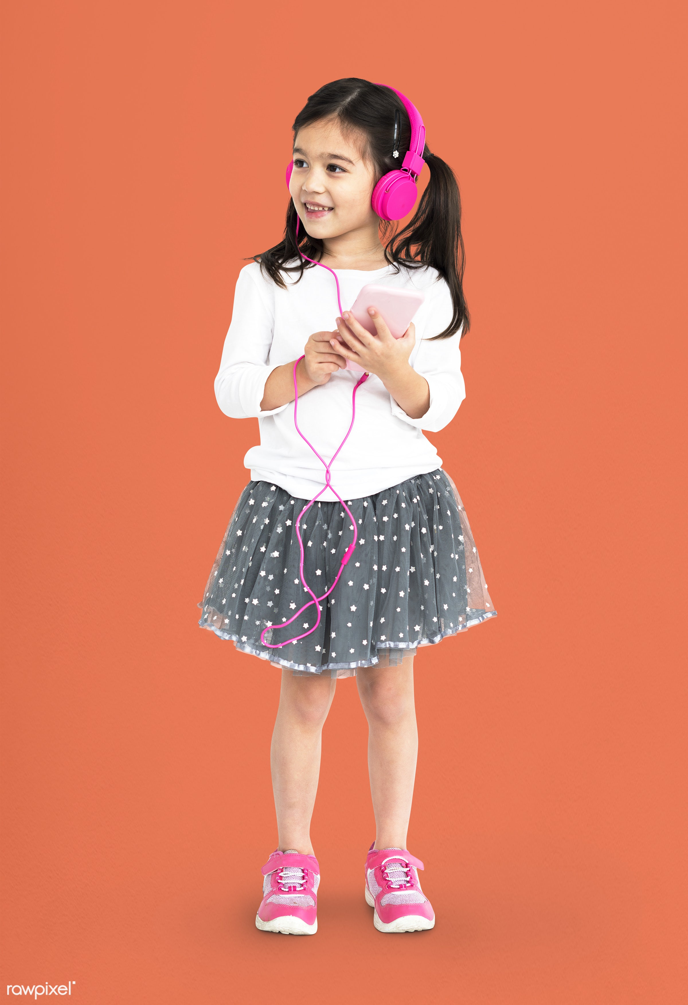 alone, asian, cheerful, child, children, girl, isolated, kid, one, playful, smiling, young, youth, listen, music, headphones...