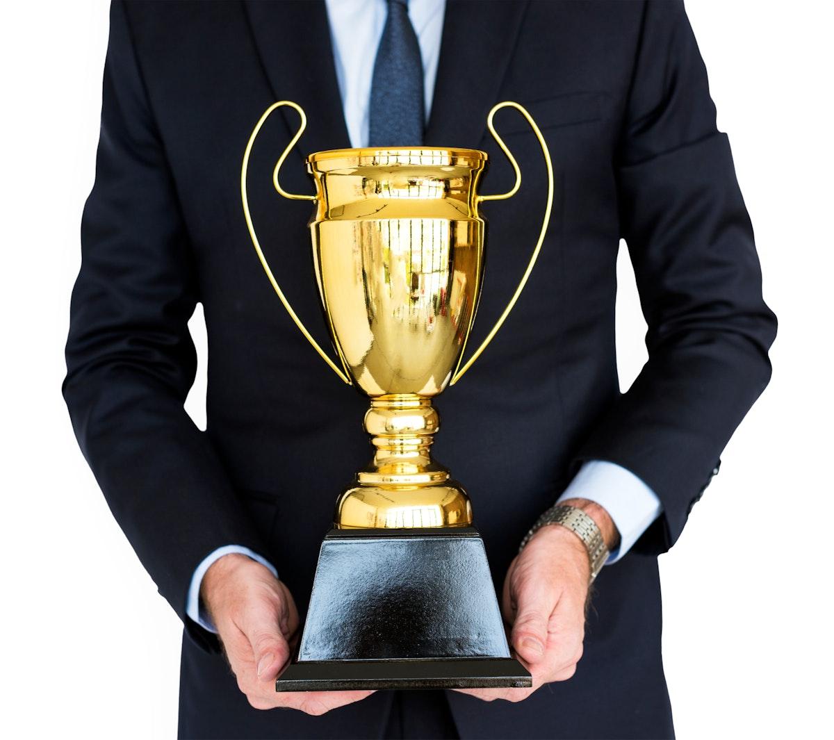 Business Man Holding Trophy Award