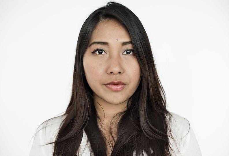 Woman Serious Studio Portrait Concept