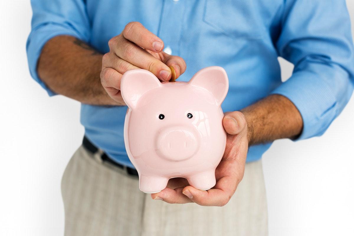 Man Holding Piggy Bank Saving Portrait Concept