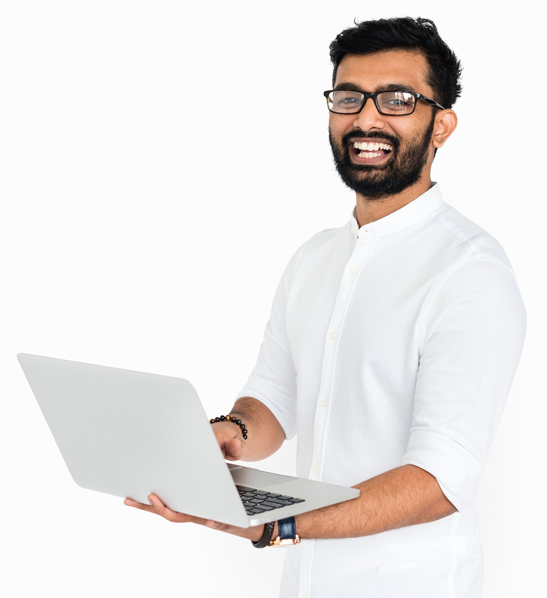 Smiling Indian guy with a computer
