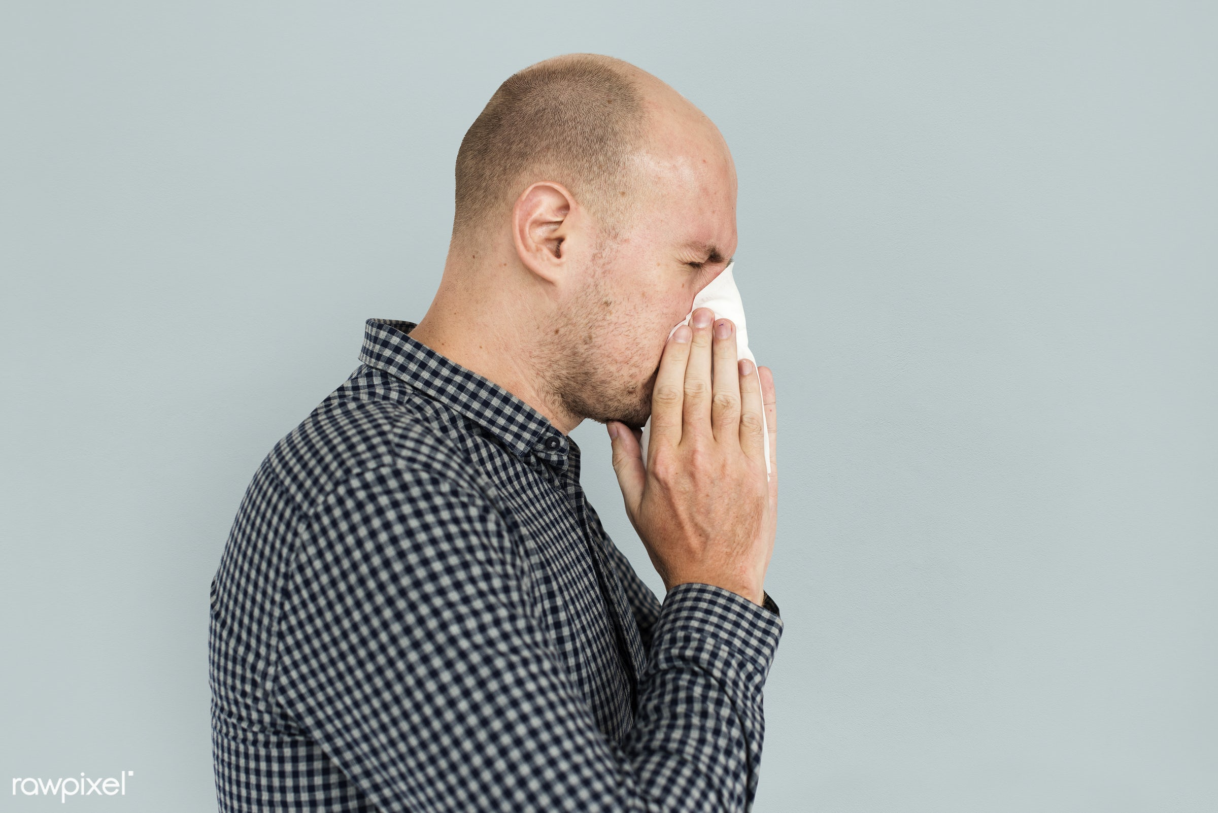 allergy, blowing nose, cold, ill, man, portrait, sick, sneezing, solo, studio, tissue, unwell