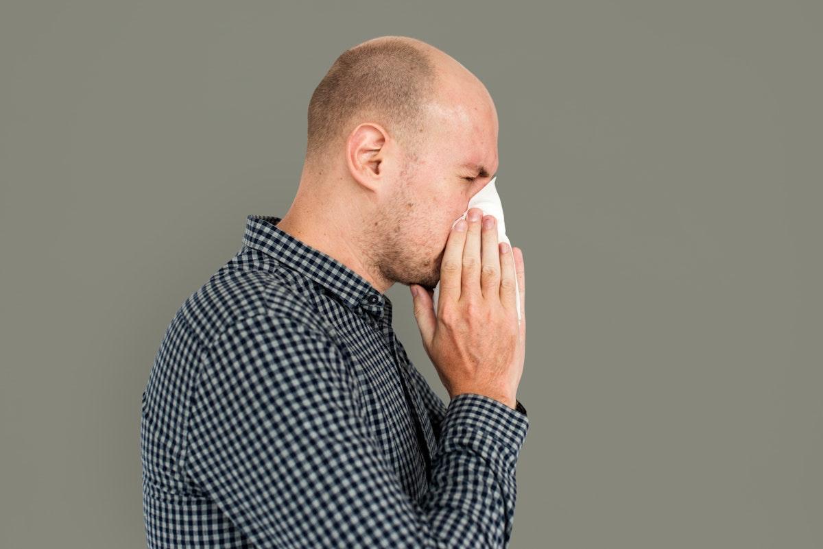Man Sneezing Studio Portrait Concept