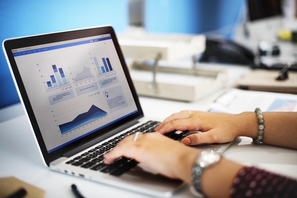 Closeup of hands using computer laptop