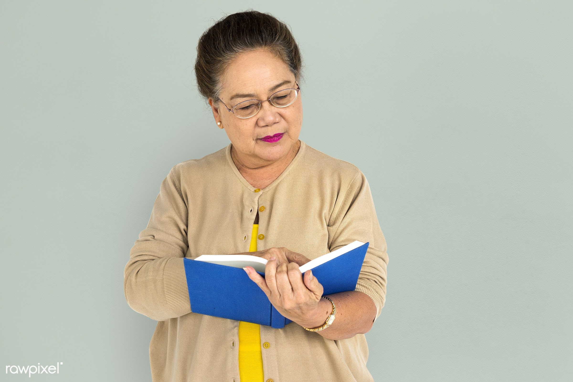 studio, expression, pastel, reading, person, holding, people, asian, story, woman, lifestyle, cheerful, smiling, isolated,...