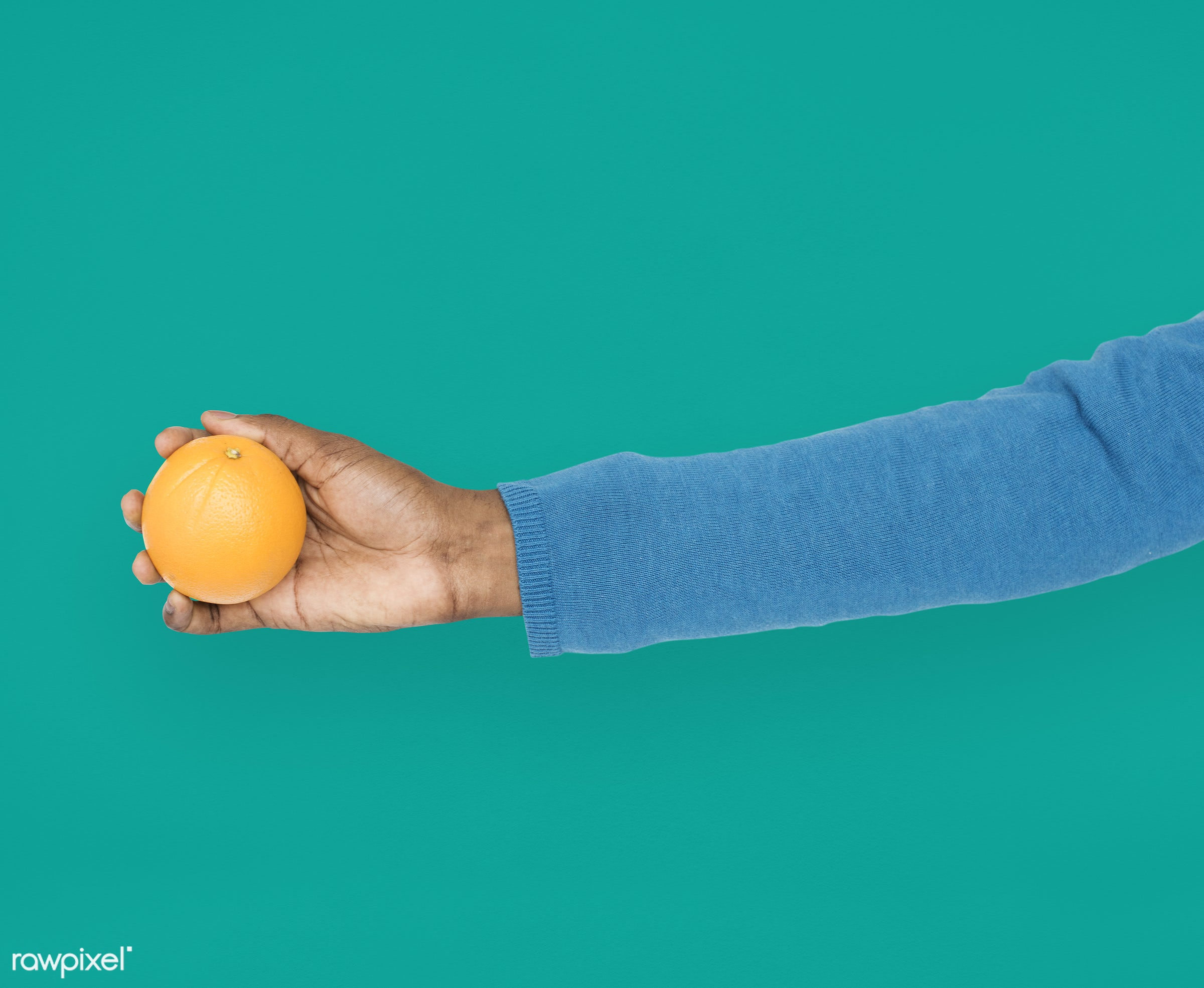 person, diet, race, hand, nature, wellness, lifestyle, showing, orange, isolated, fruit, green, african descent, gesture,...