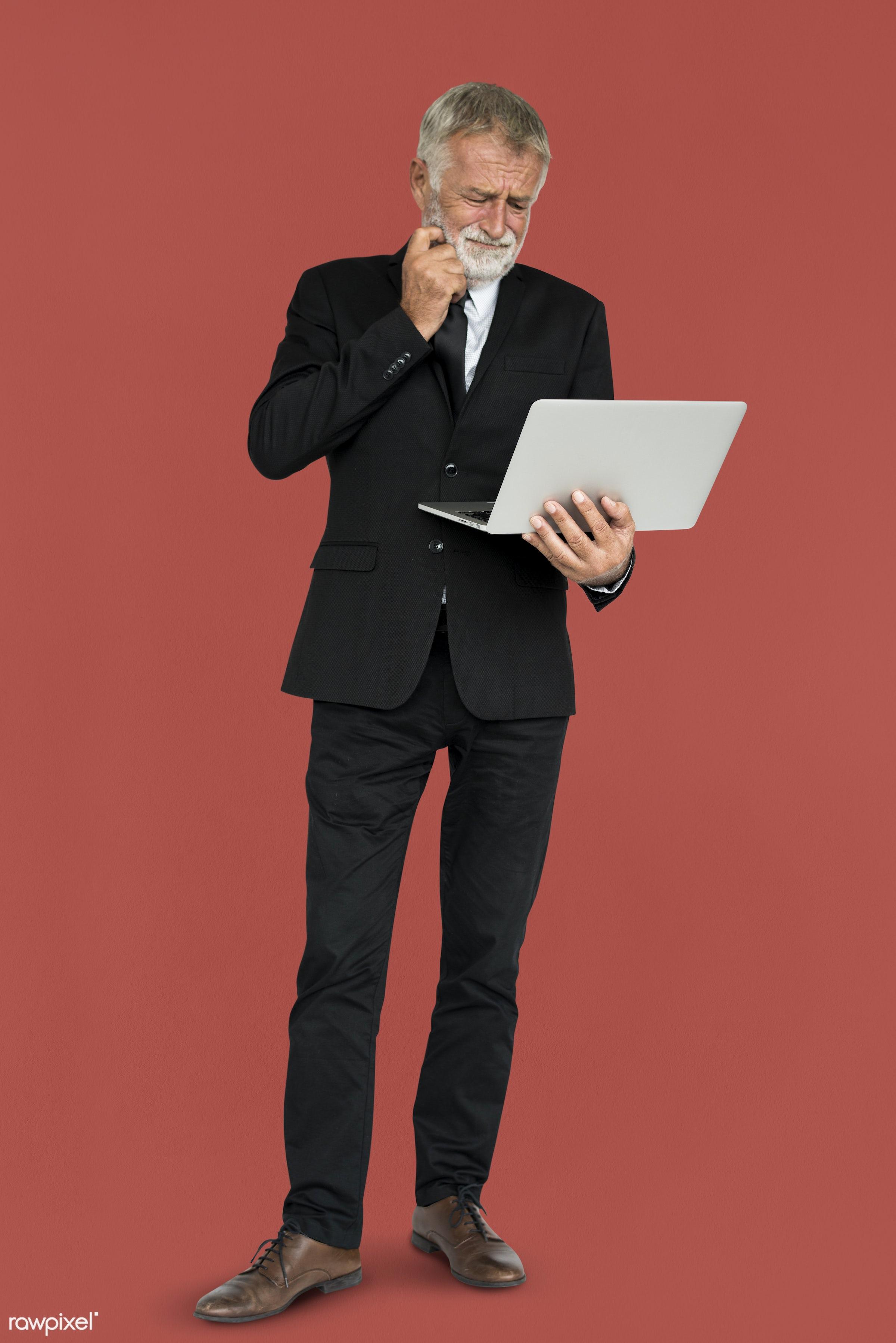beard, business, laptop, man, senior, standing, suit, thinking, work, working