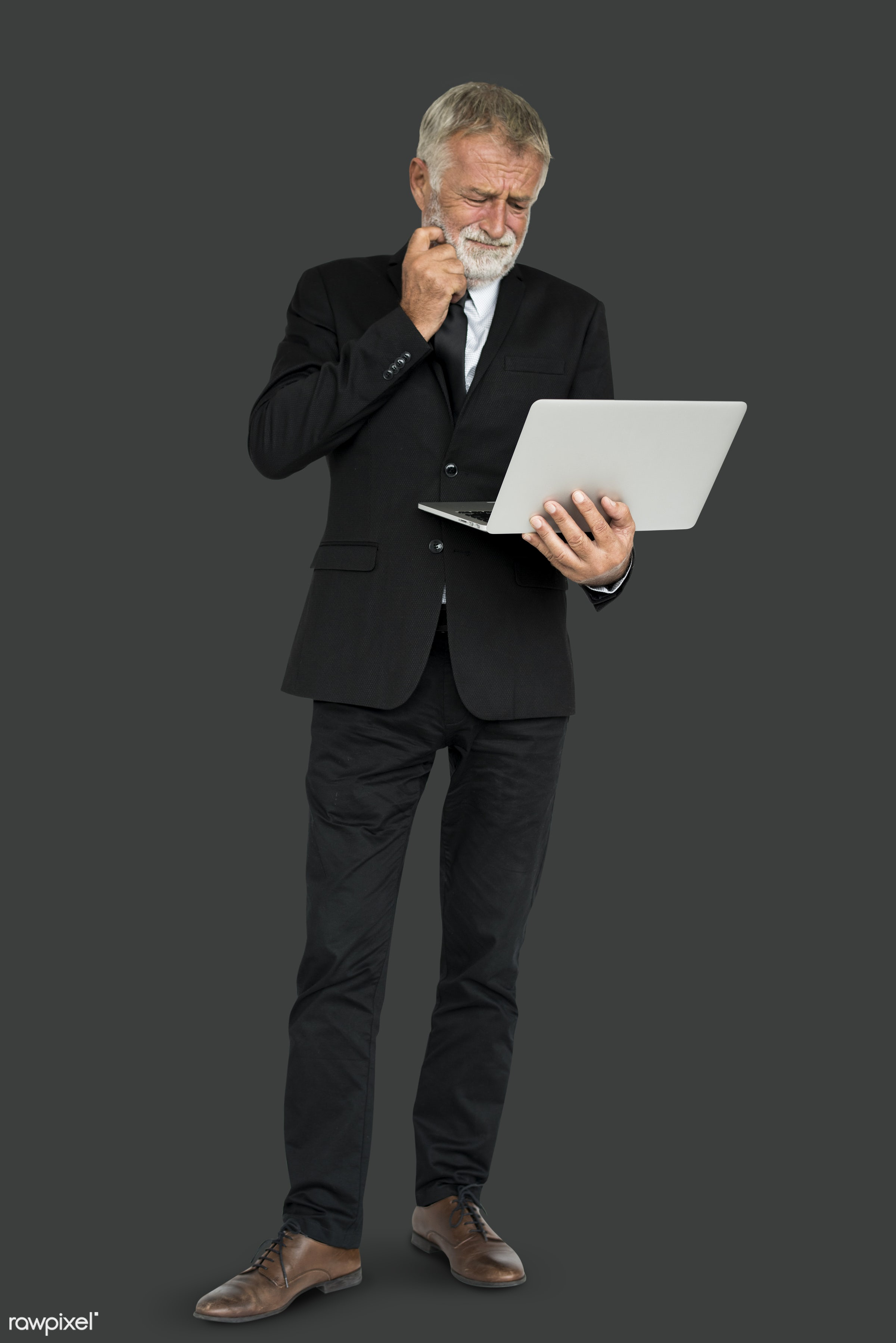 business man, hold, holding, laptop, man, stand, standing, suit, think, thinking