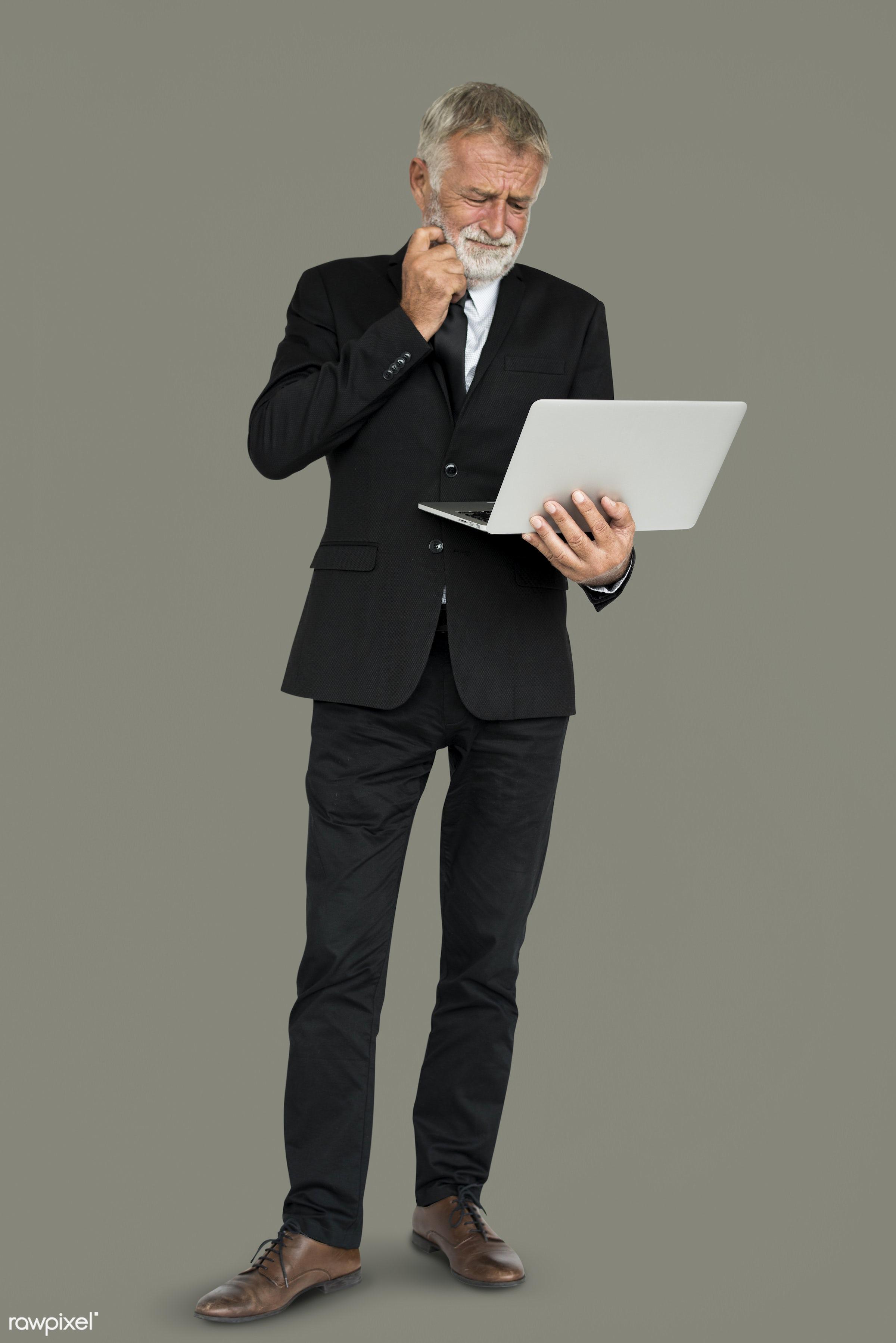 hold, holding, laptop, man, senior, standing, thinking, type, typing, work, working
