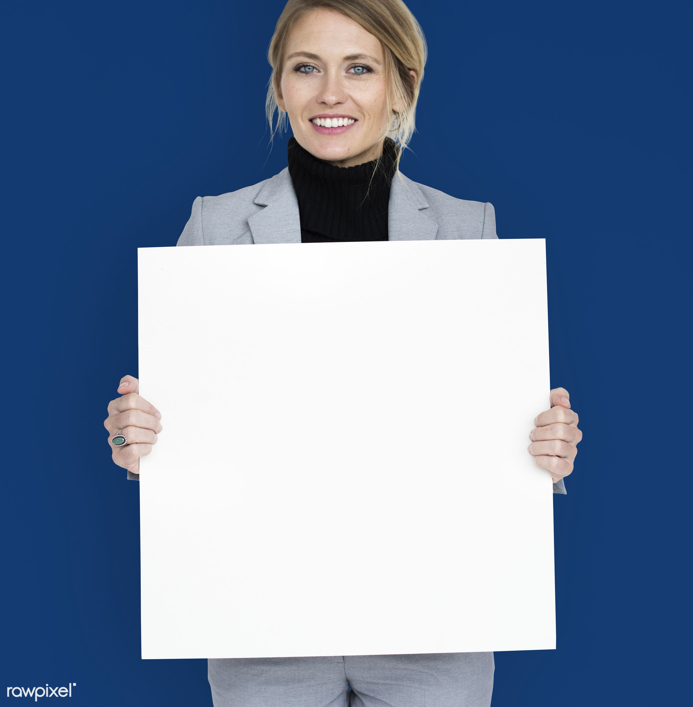 studio, expression, person, holding, people, placard, woman, smile, cheerful, smiling, isolated, happiness, businesswoman,...