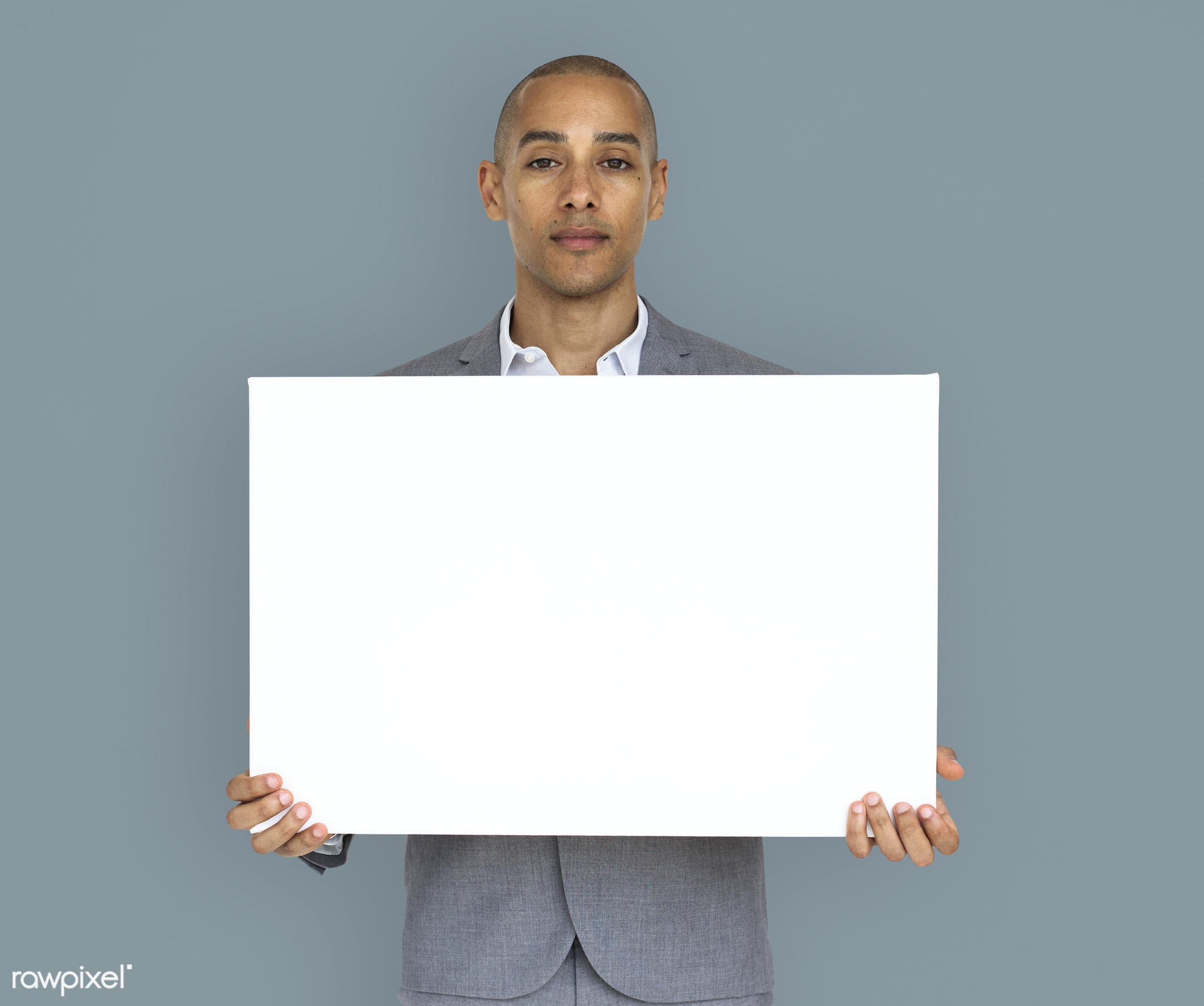 expression, studio, copy space, person, holding, people, business, placard, businessman, grey, mixed race, man, banner,...
