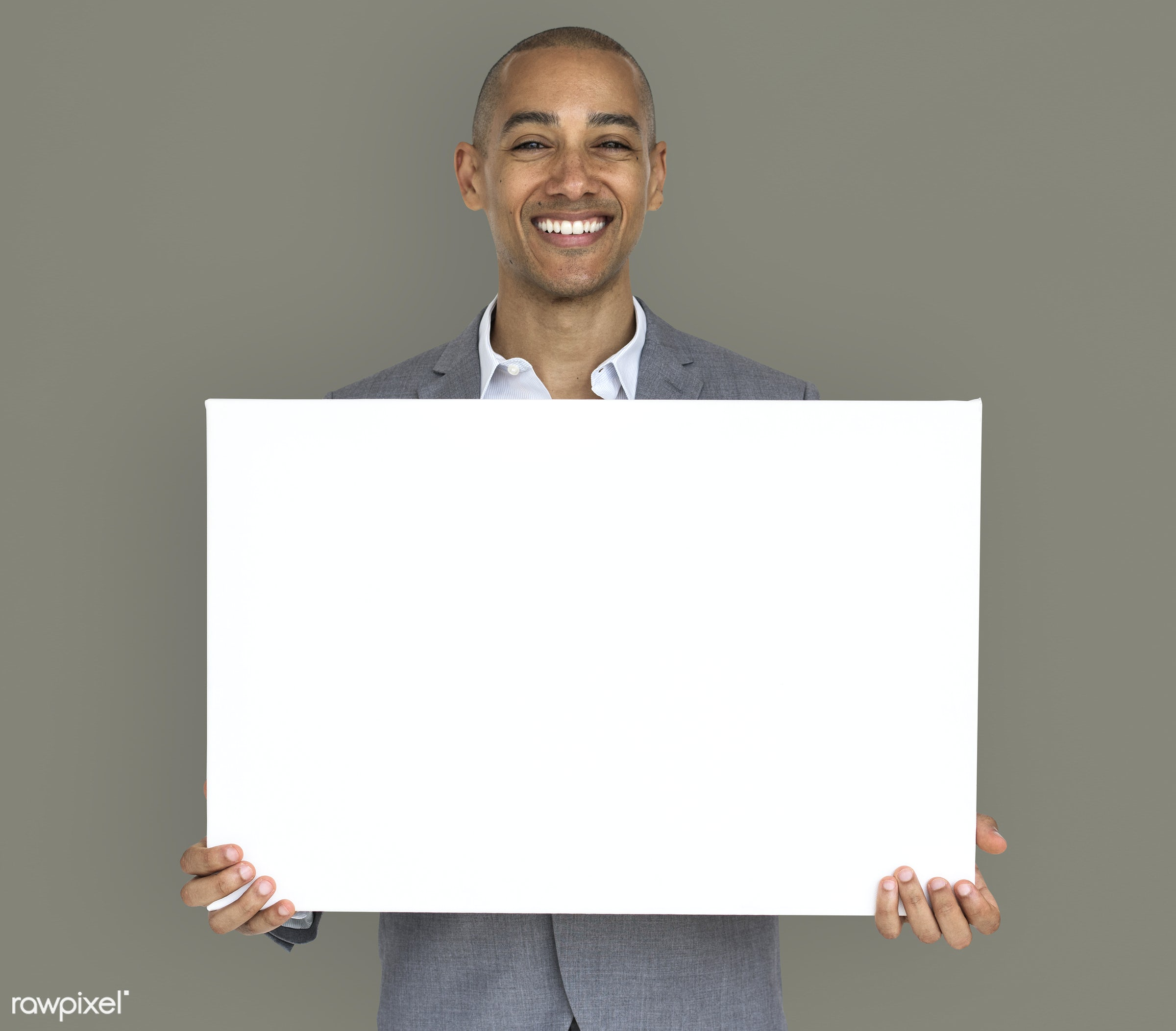 expression, studio, copy space, person, holding, joy, people, business, placard, businessman, happy, grey, mixed race, smile...