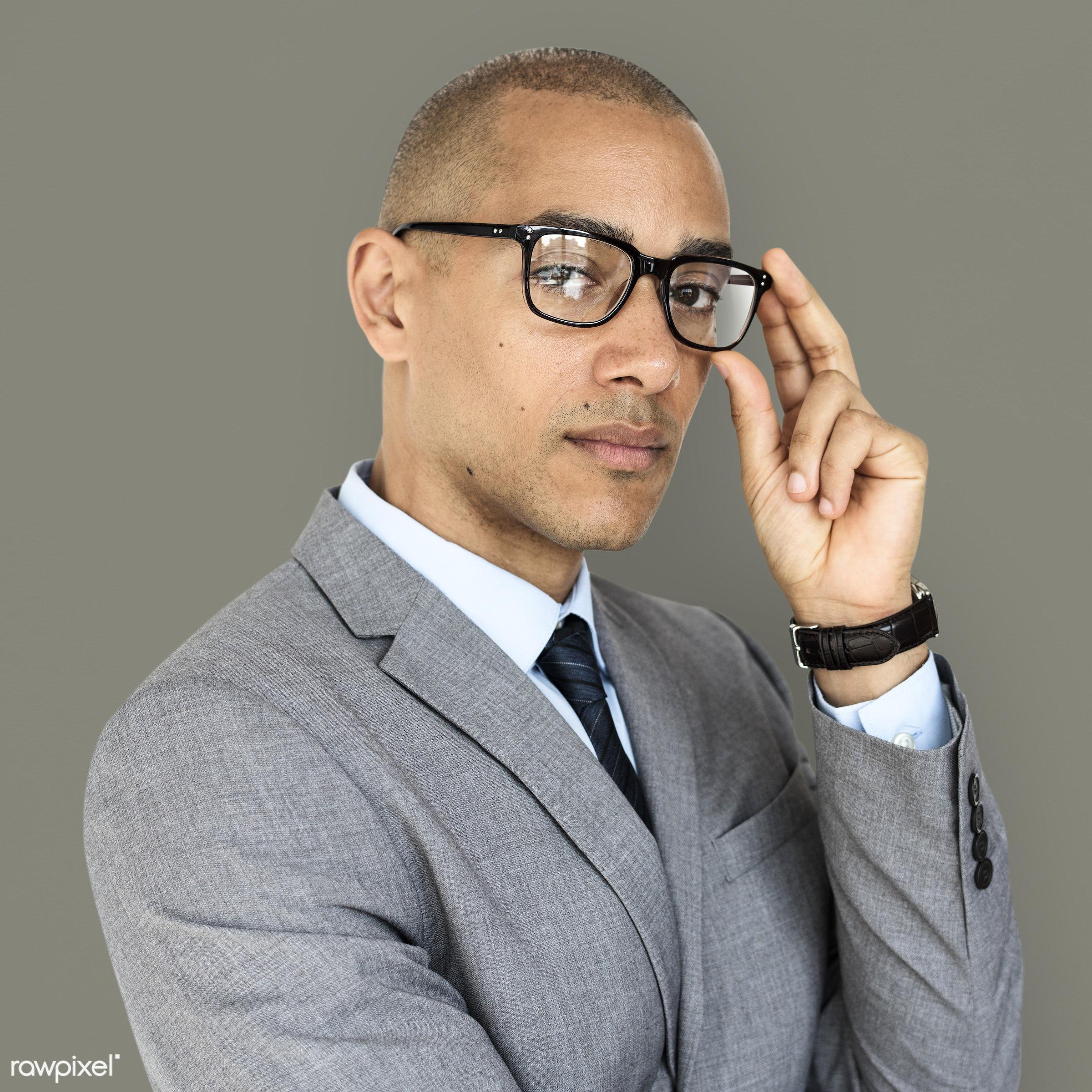 adult, african descent, background, black, business, business man, business wear, expression, focused, formal, formal wear,...
