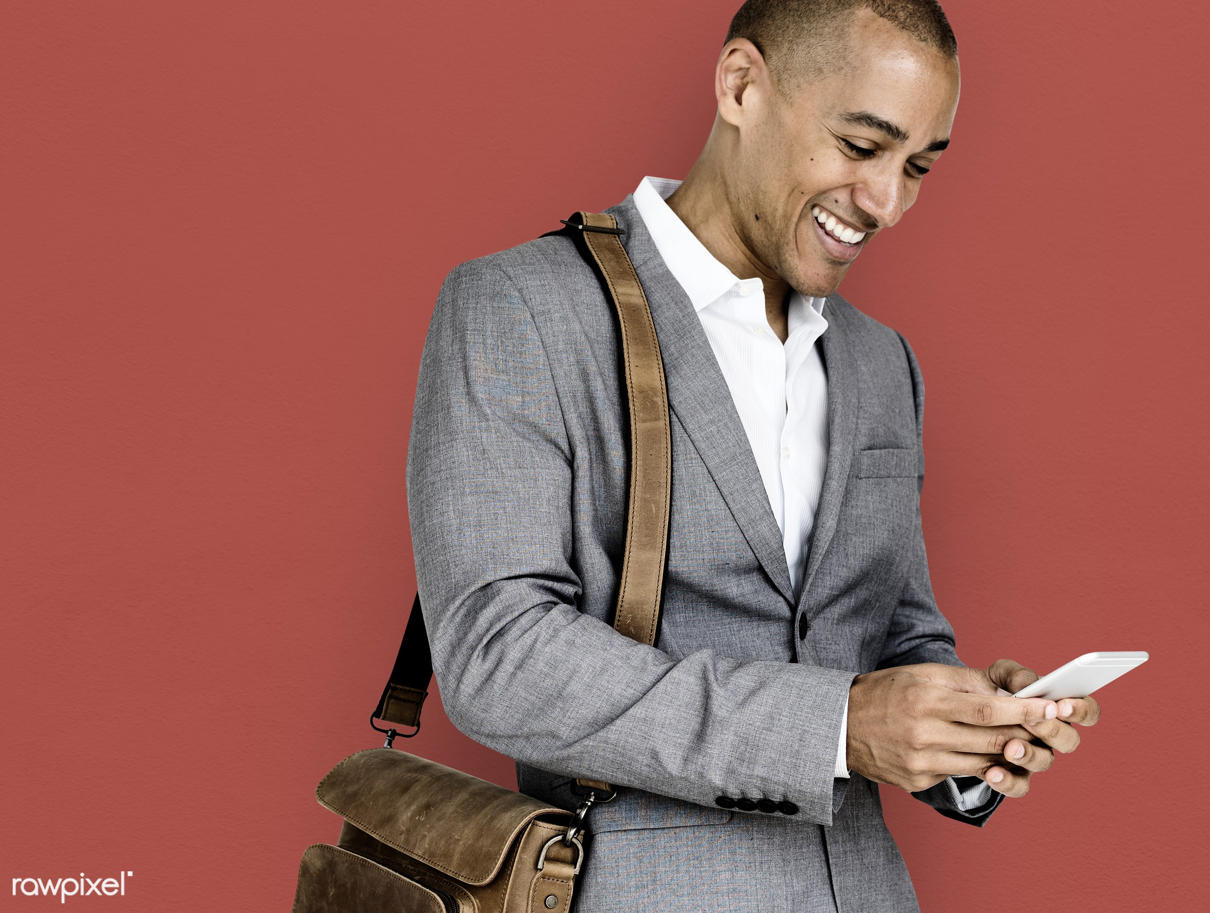 expression, studio, person, phone, business wear, messenger bag, joy, people, joyous, happy, messaging, smile, cheerful, man...